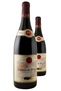 E. Guigal Cotes du Rhone Rouge  , $12 - $15  This full-bodied bottle possesses a bouquet of berry and spice, leading to a palate of black fruits, a touch of chocolate and green vegetation, all in a silky texture.