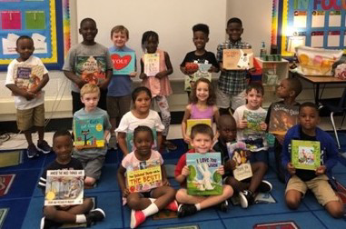 Students with their donations from BookTini - Brooklyn