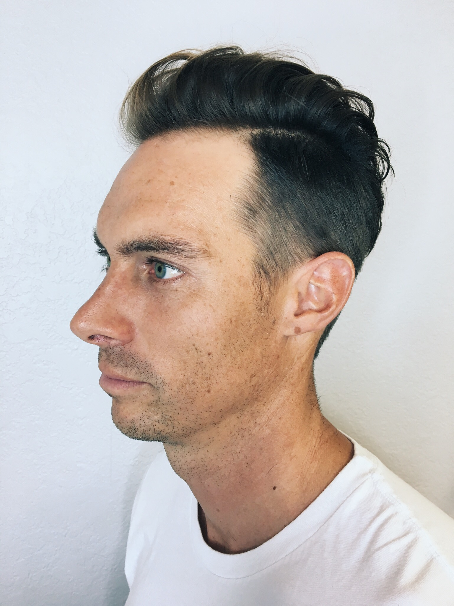Fresh pompadour with a bit of curl for that salty surf look.