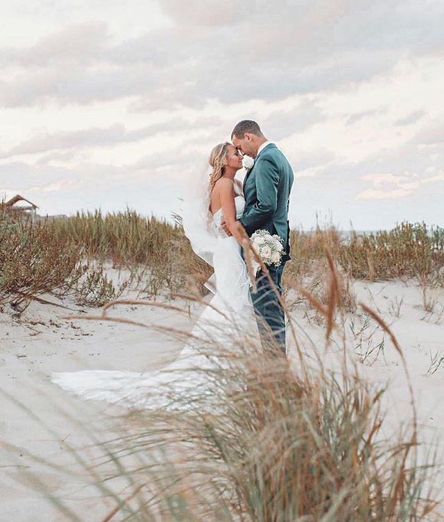 FOREVER MOMENTS ✨ Congrats Emily + Dylan! Just one of the many amazing weddings our Salty Team did last year. Hair by Britt Duffy + Esther Faith and MU by @saltyhairstylist // #saltyhairsalonobx #saltyhairclub #obxwa #outerbankswedding #obxwedding #outerbanks #obx