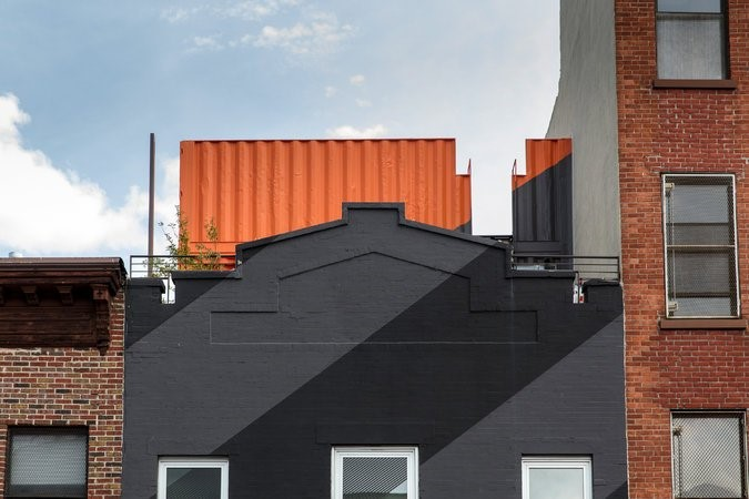 On Irving Place, in Clinton Hill, Brooklyn, a shipping container serves as a rooftop addition.CreditPreston Schlebusch for The New York Times
