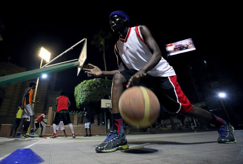 A Sudanese refugee dribbles the ball during a basketball game in Cairo, Egypt September 24, 2018. REUTERS/Mohamed Abd El Ghany
