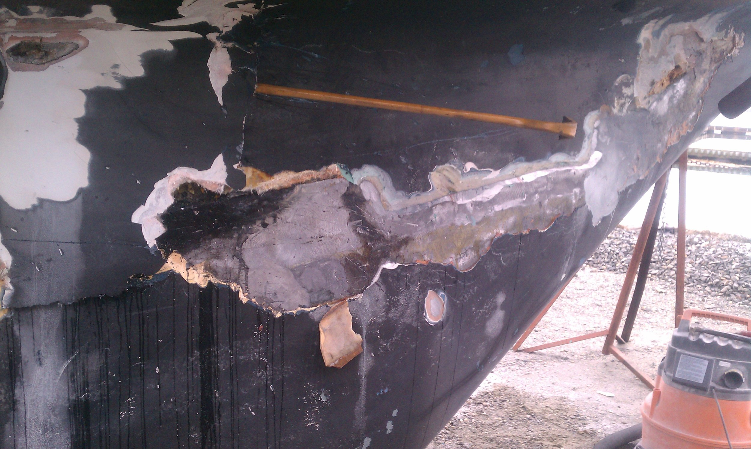 Initial investigation below the keel to hull joint revealing severe damage.