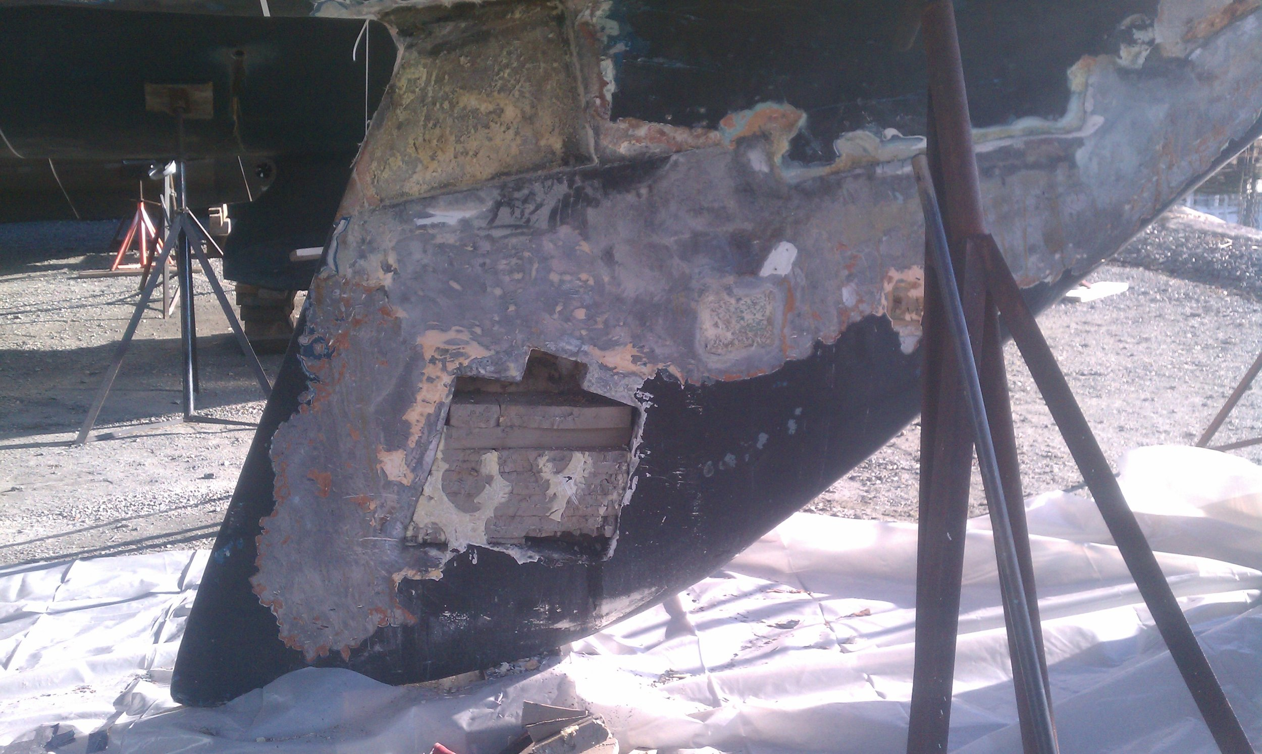 Further investigation revealed the keel was changed at some point requiring a waterproof repair where the keel bolt needed to be tightened vs a grid system embedded in the lead from the factory.