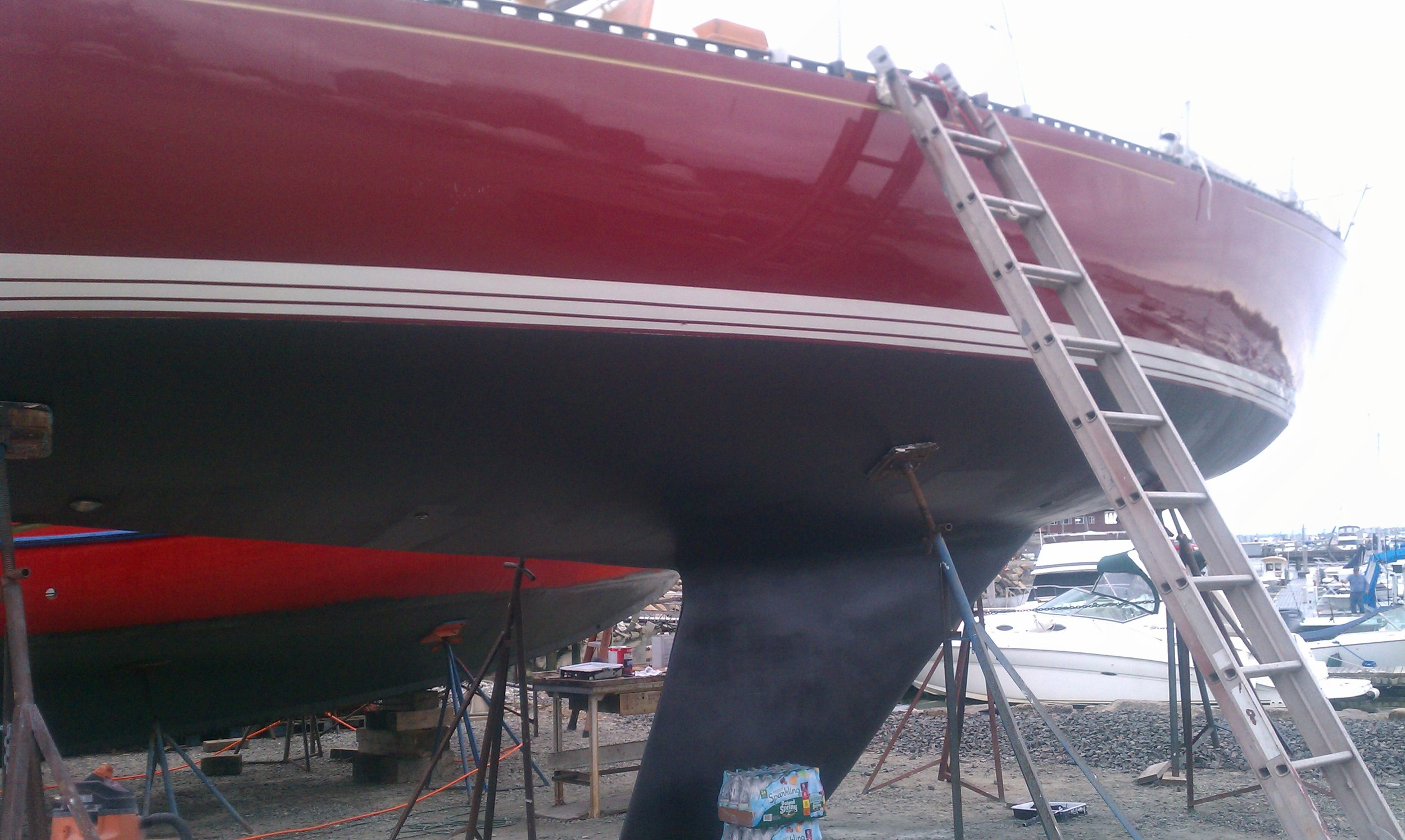 C&C 43' Sailboat with finished keel and buffed gelcoat sides getting ready for launch.