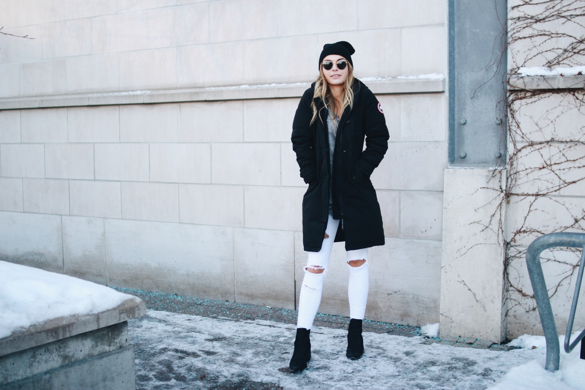 Coat: Canada Goose, Sweater: Brandy Melville, Hat: Raising the Roof, Sunglasses: Ray Ban, Pants: TopShop, Boots: Aldo