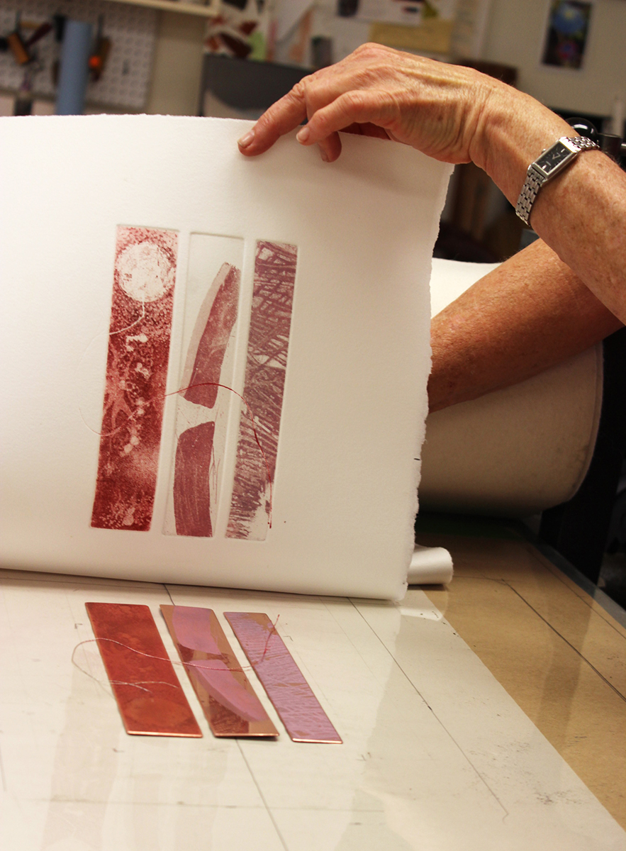 "Pulling my ""Three Red Bars"" etching from my press on Print Day in May, 2017."