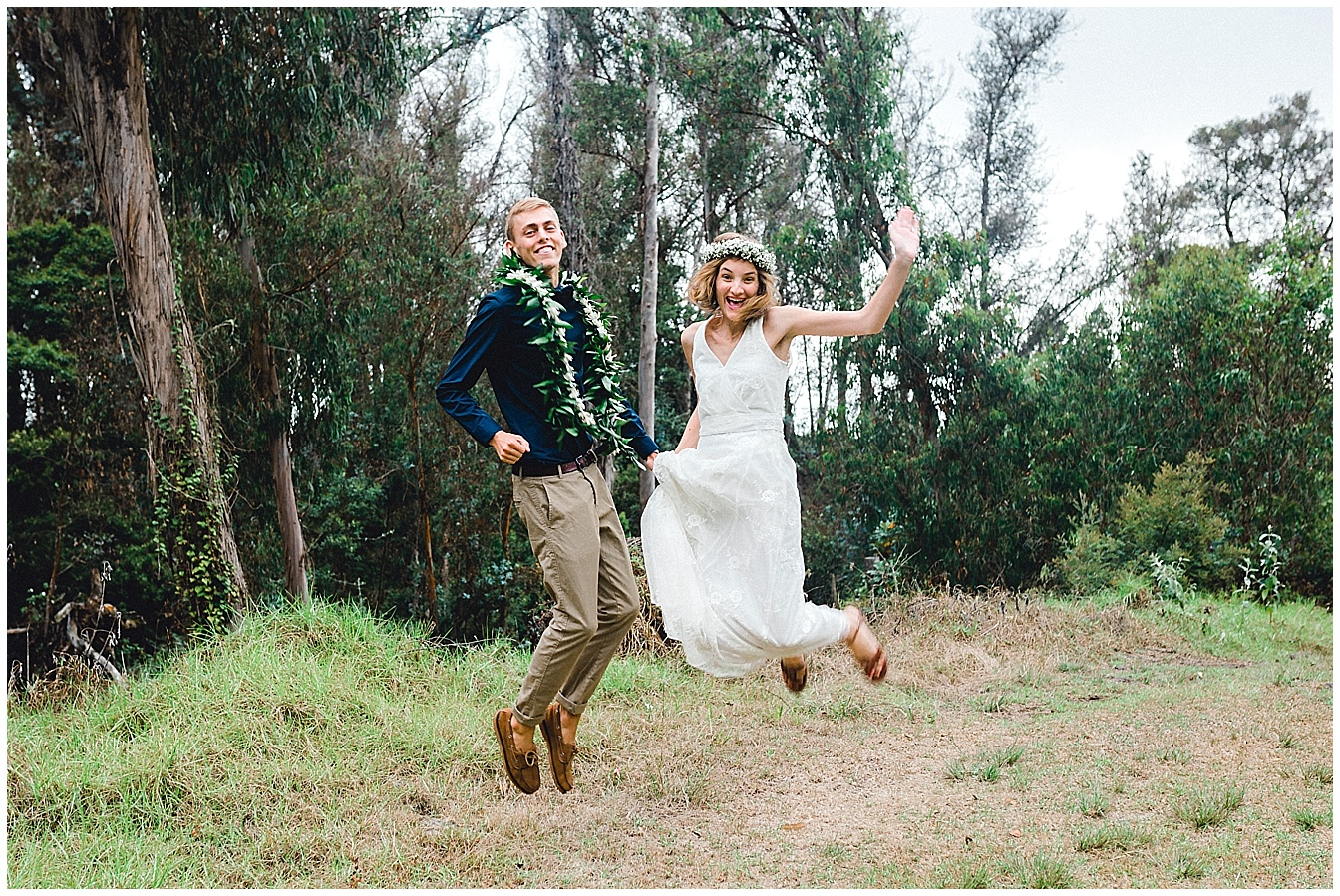 Maui bride and groom jumping for joy
