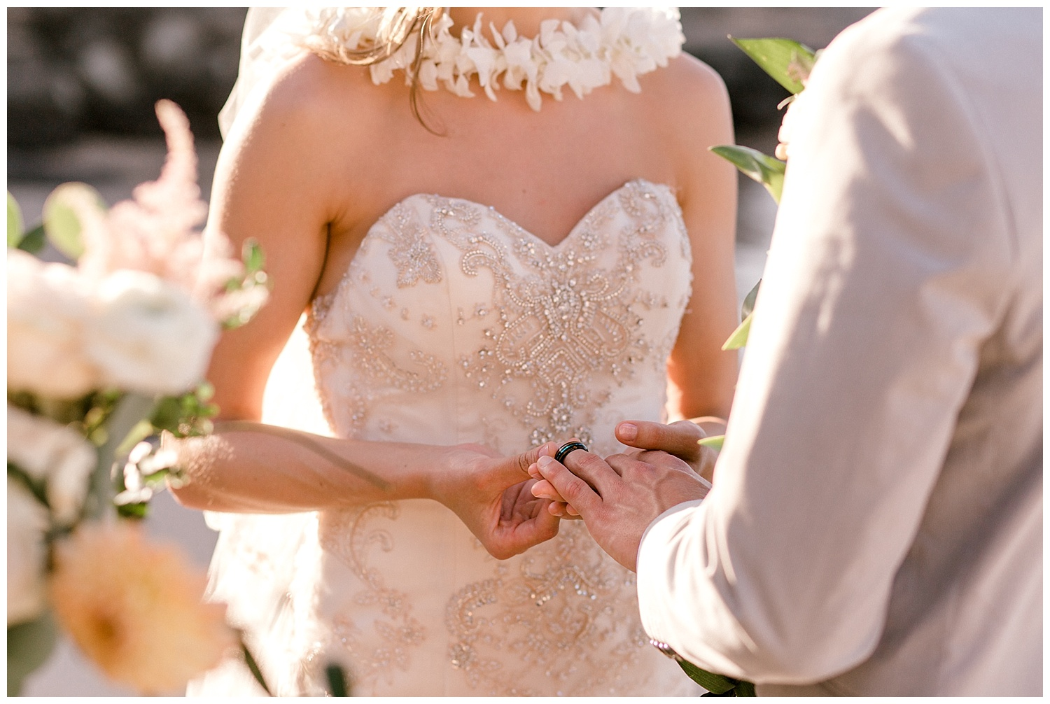 Bride and Groom Exchanging Rings during Maui Elopement