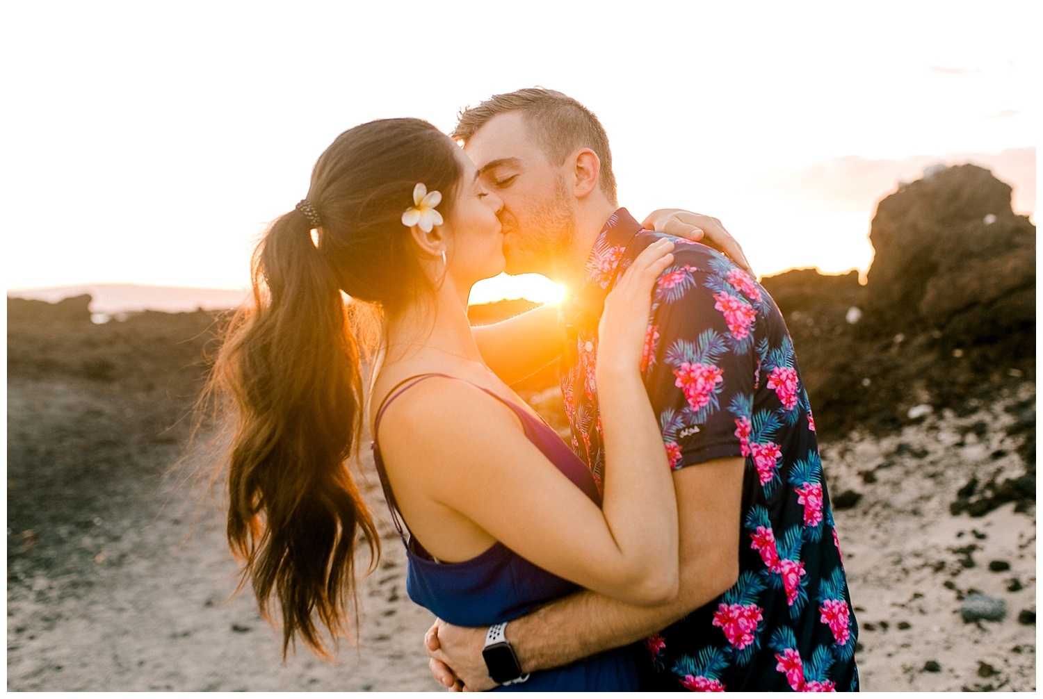 Man and woman kissing during Maui sunset