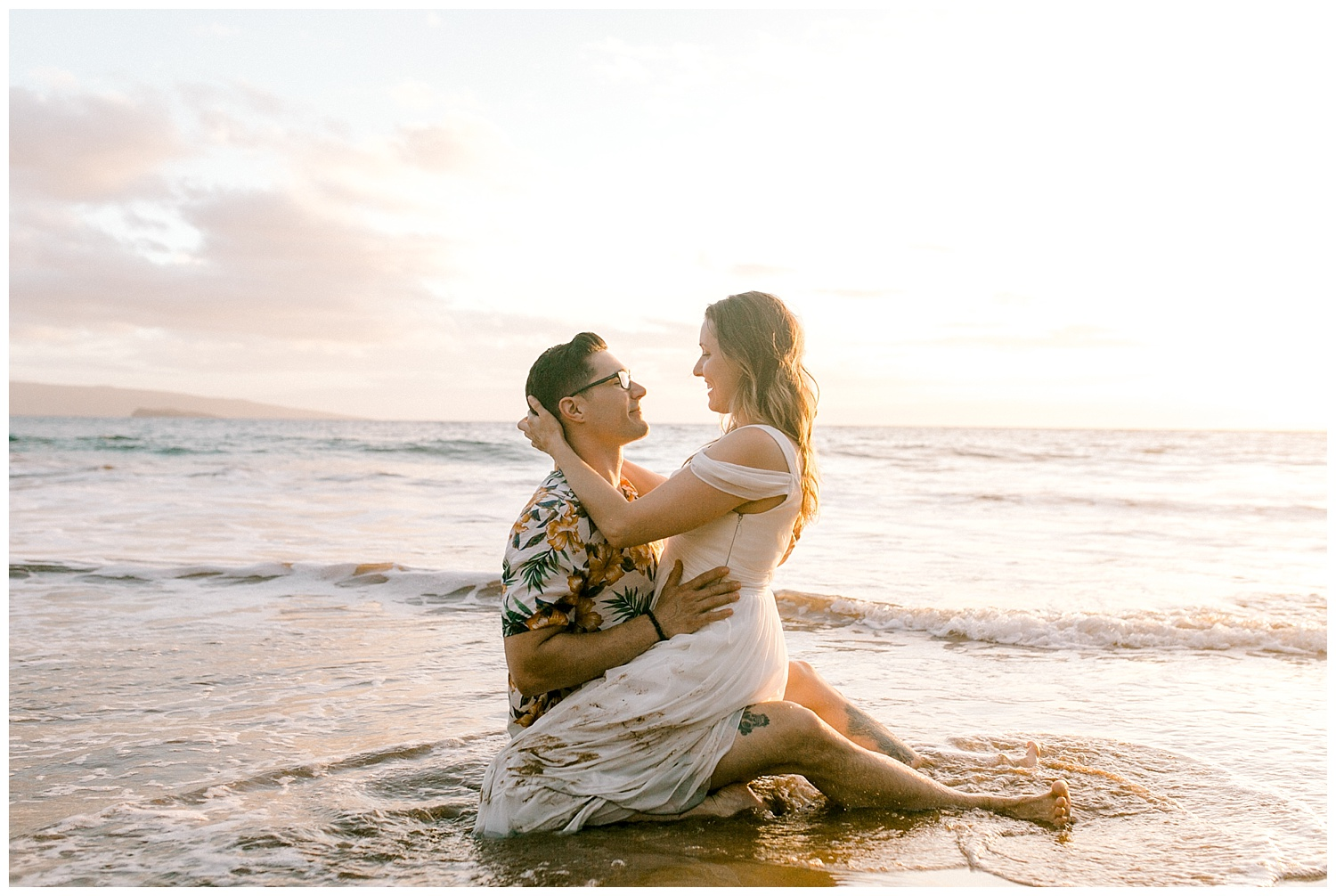 Bride and groom embracing on a Maui beach during trash the dress session