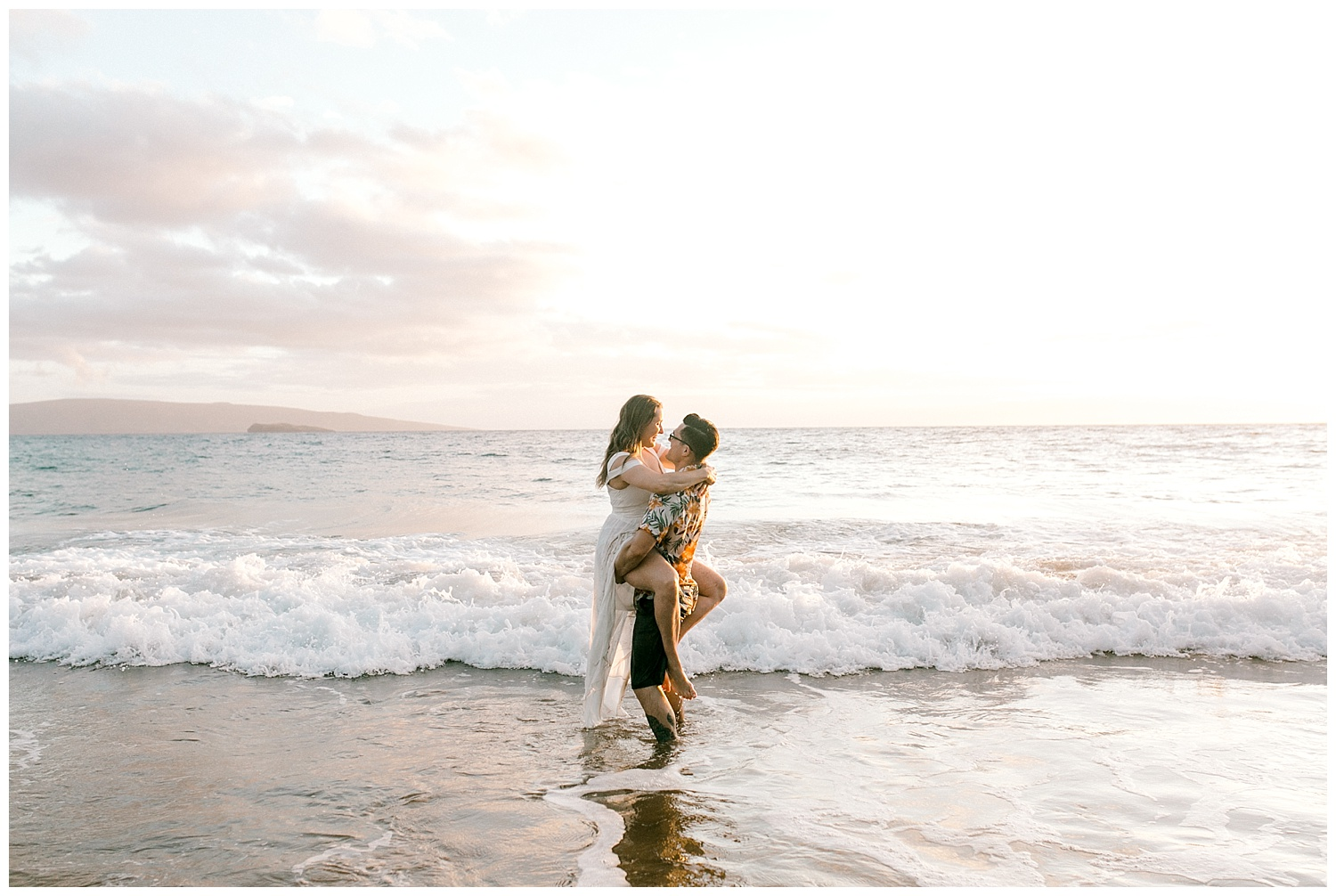 Bride and groom hugging during a trash the dress photography session on a Maui beach