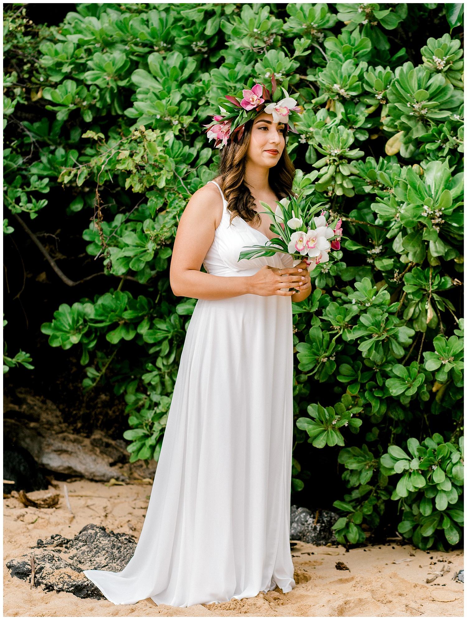 Bride walking down aisle during Maui beach elopement
