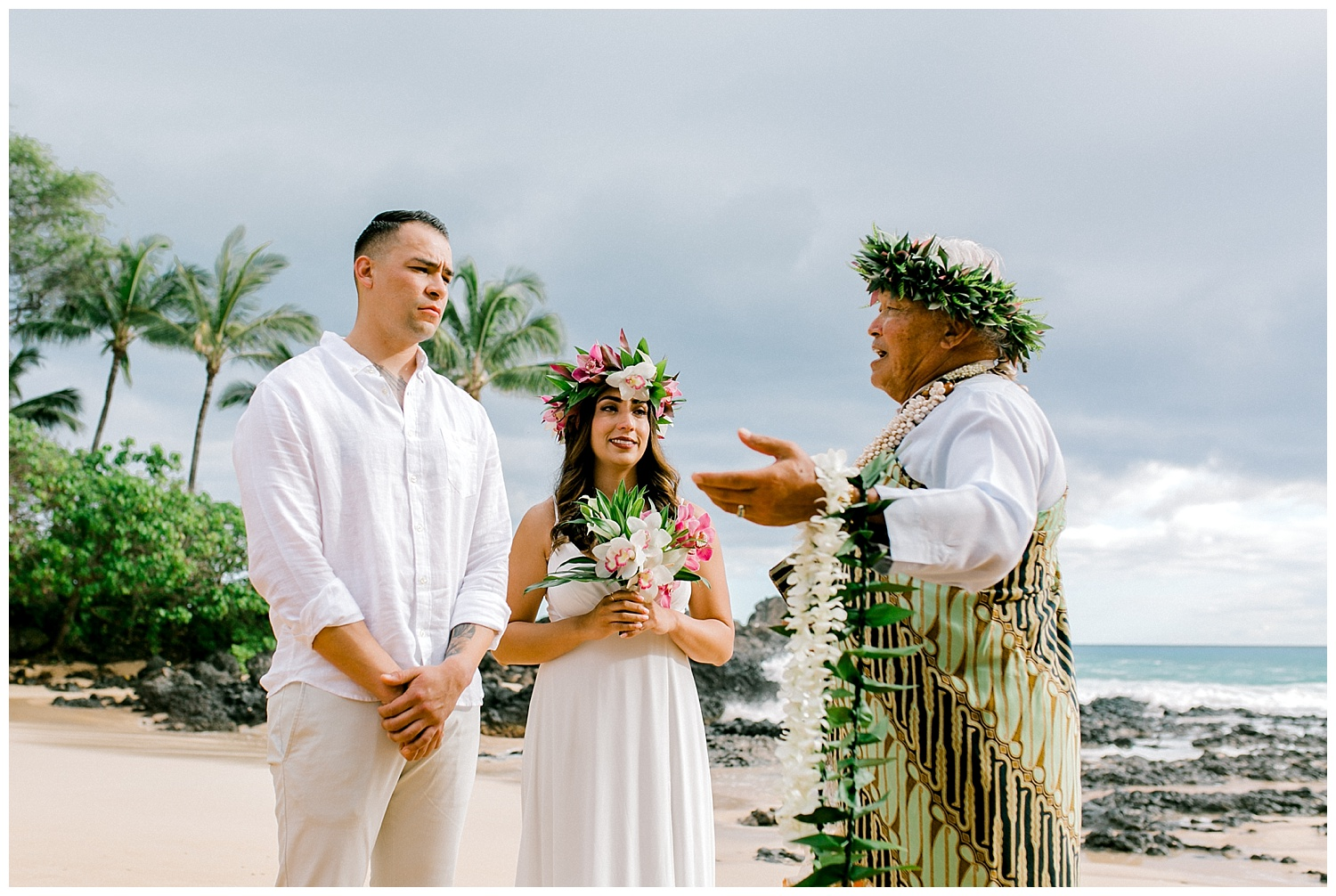 Bride and groom listening to officiant during Maui beach elopement ceremony