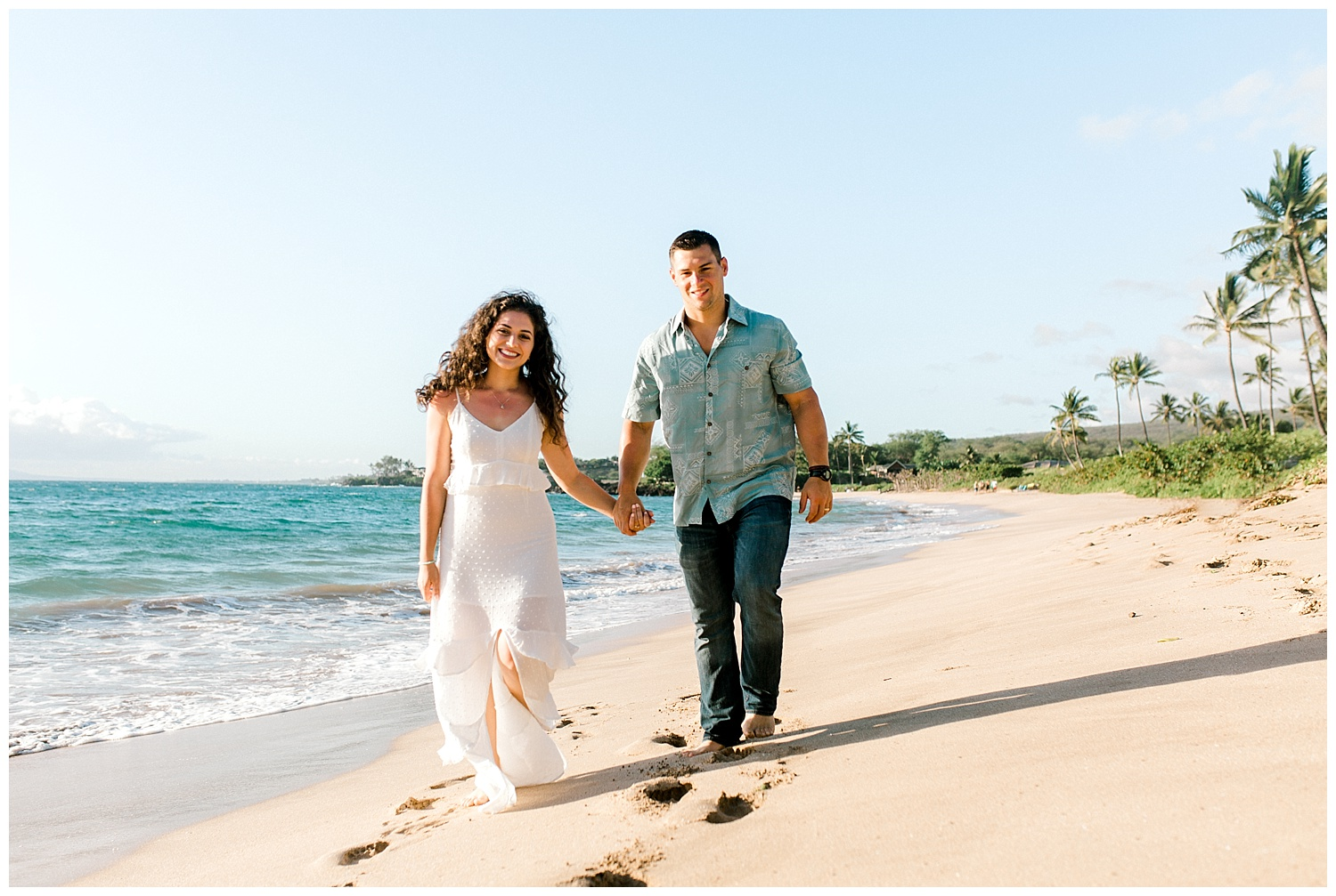 Newlyweds walking on Maui beach