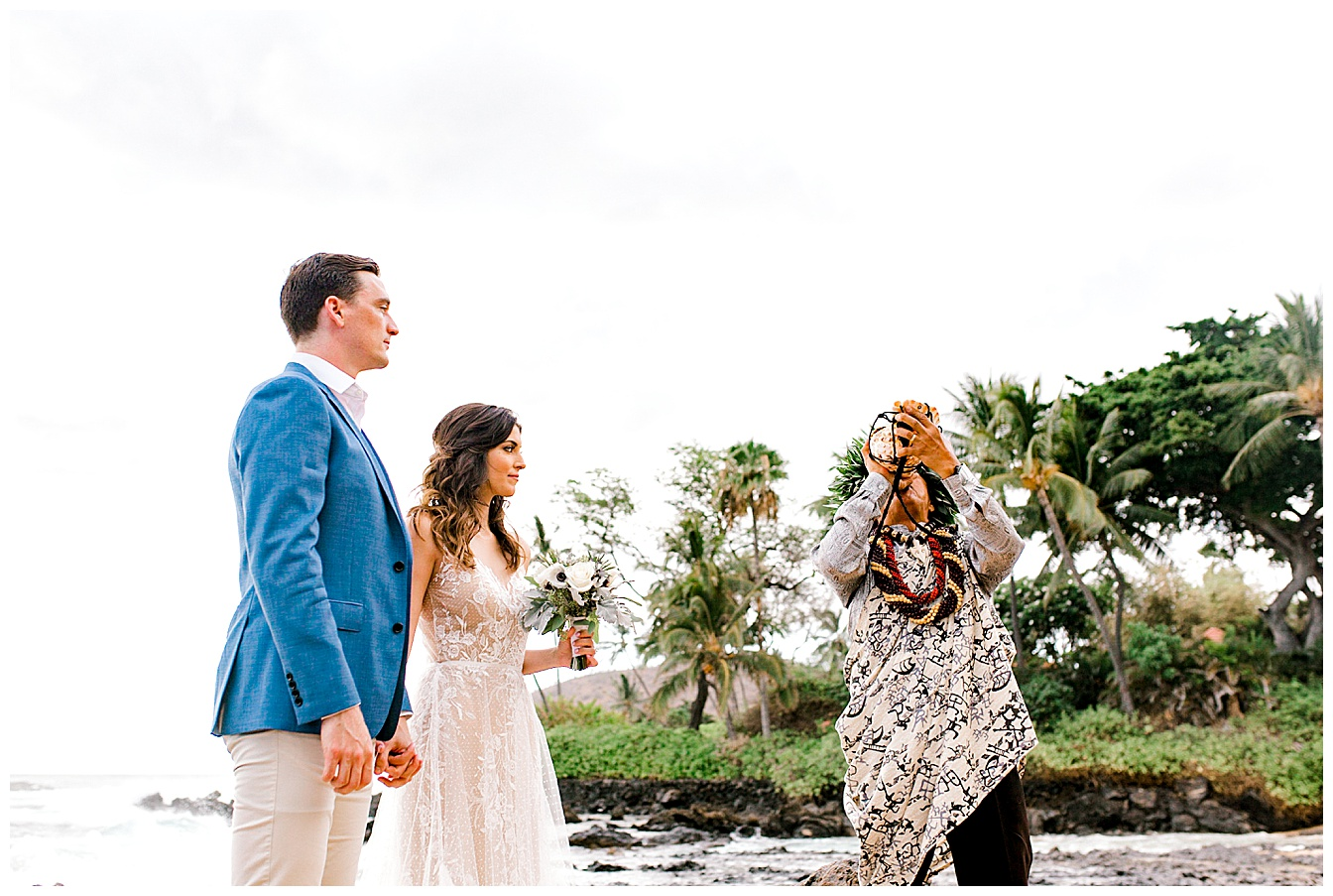Blowing of the pu, Hawaiian conch shell, at the start of a Maui wedding ceremony