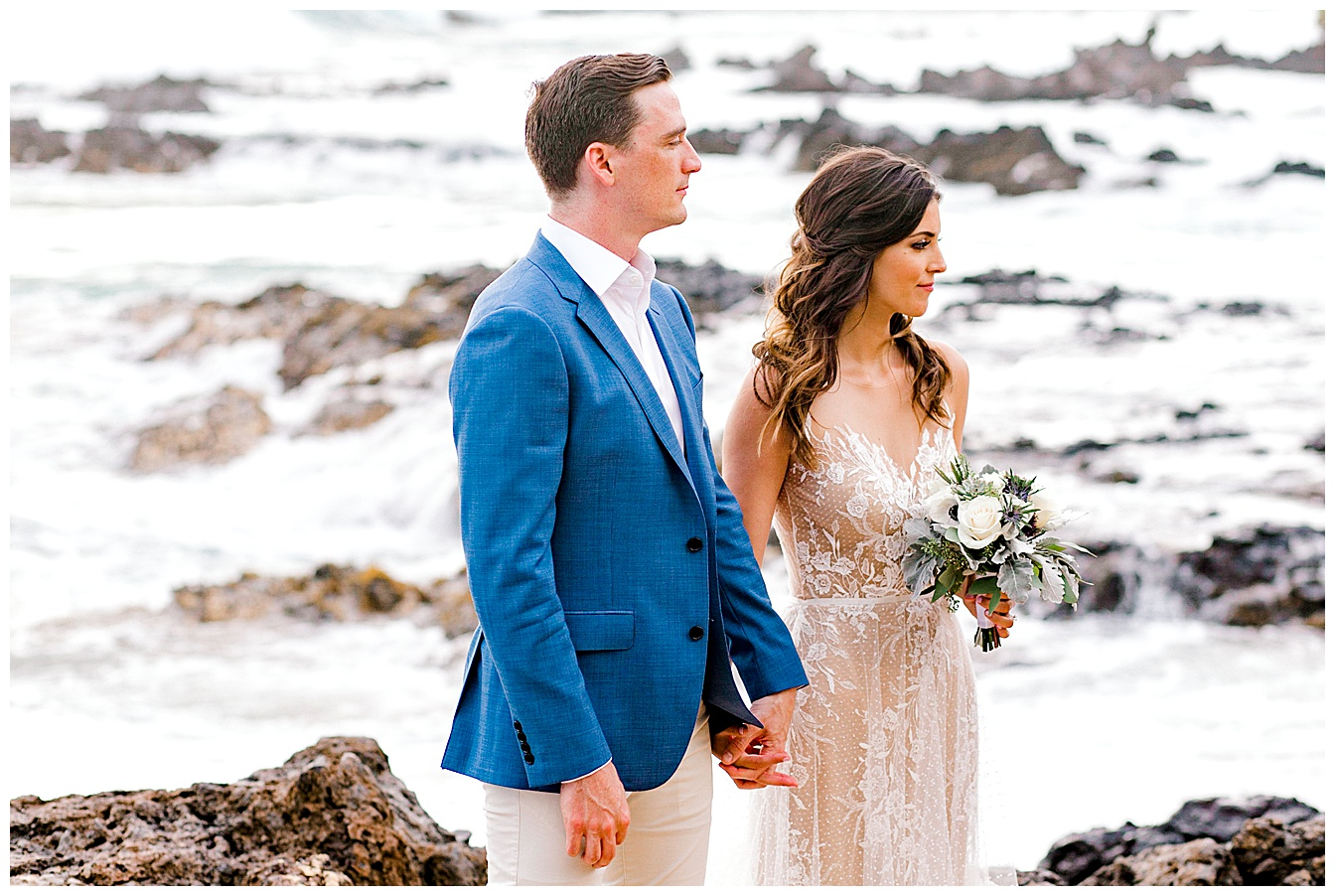 Bride and groom standing on the beach during a Maui elopement ceremony