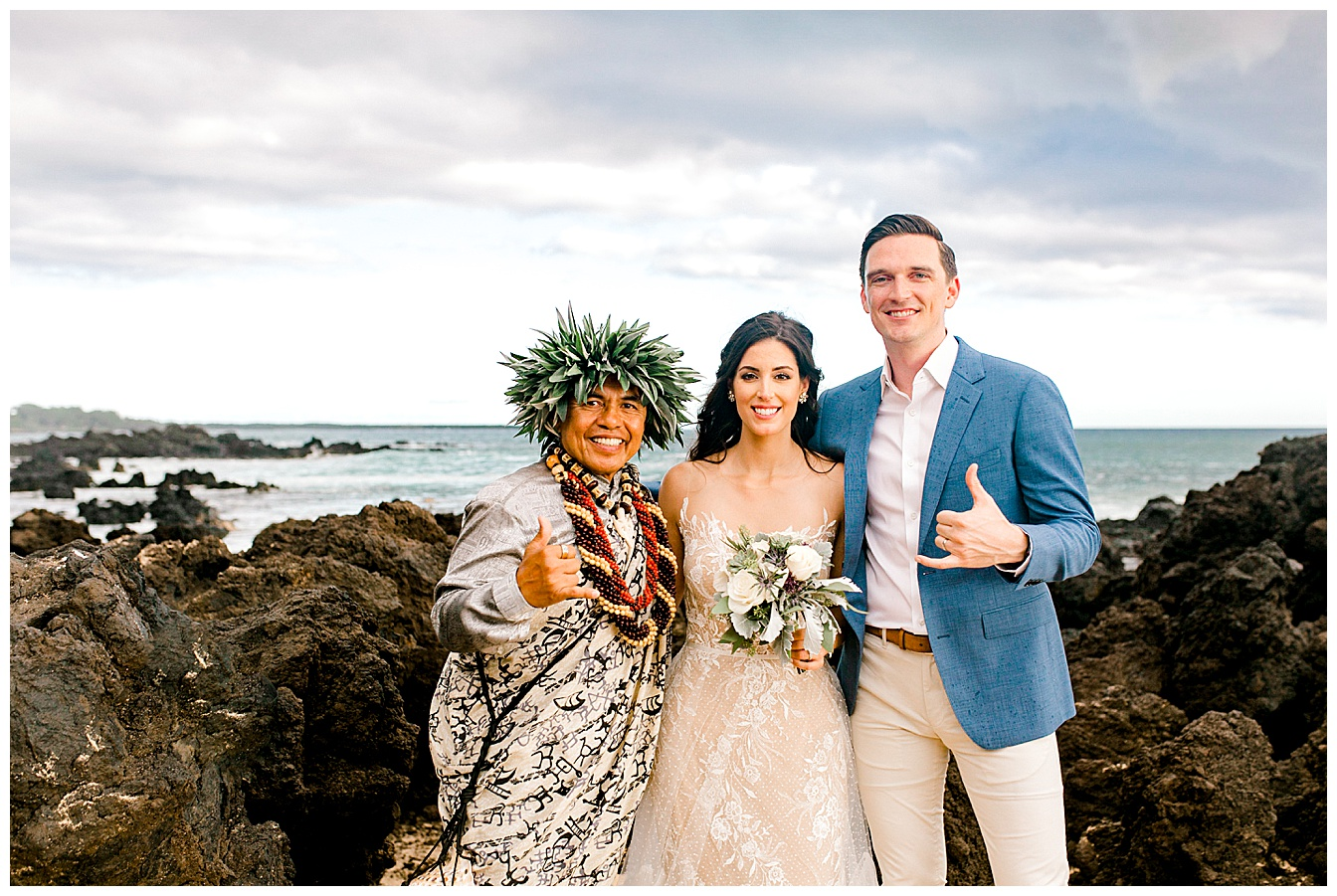 Bride, groom, and officiant giving the shaka following a Maui elopement ceremony