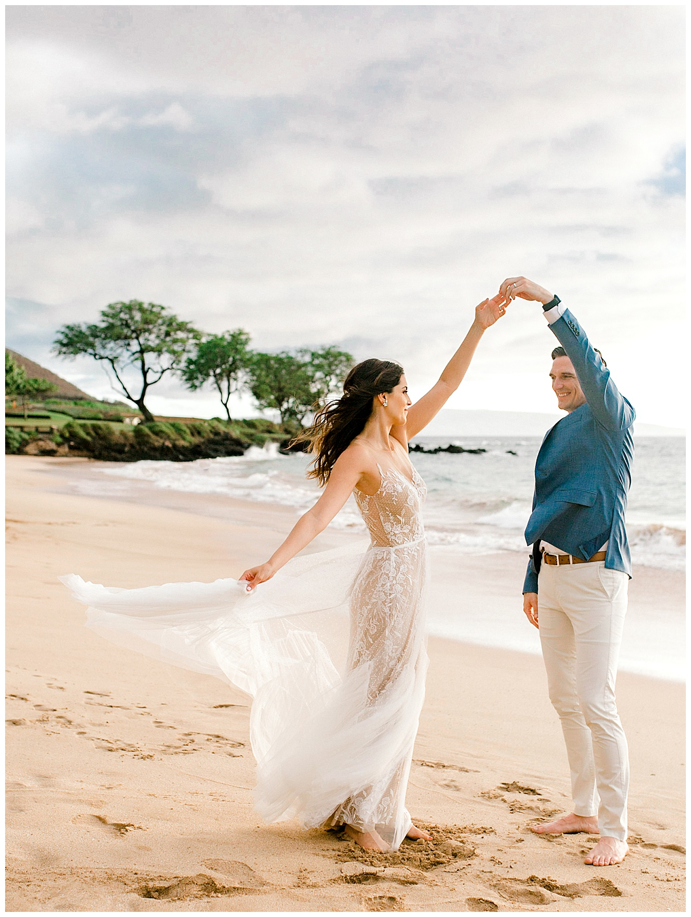 Bride and groom dancing on a Maui beach