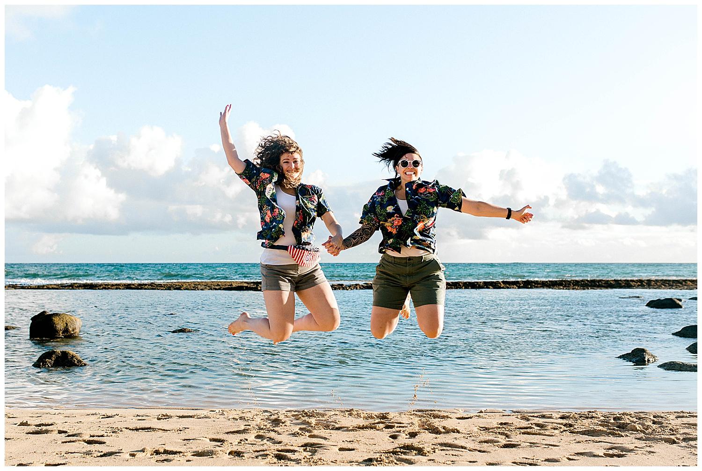 Couple jumping on Baldwin Beach