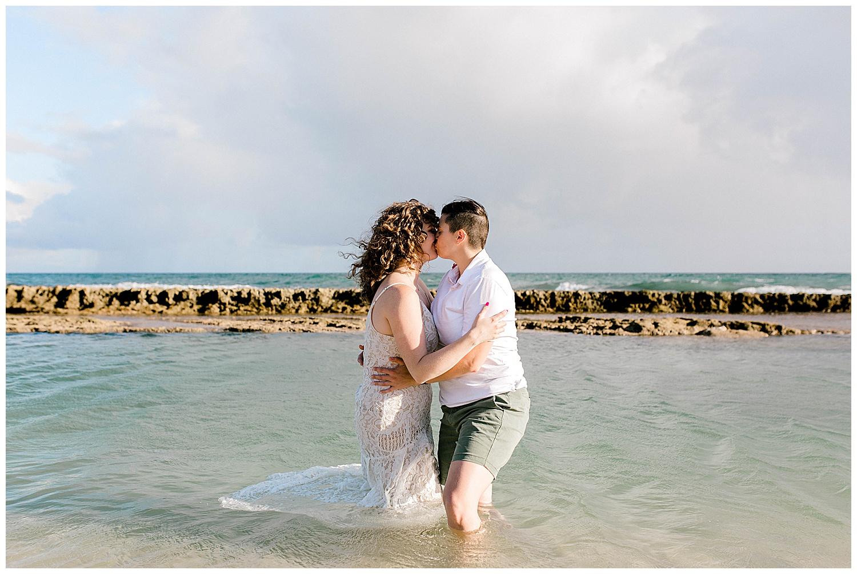 Couple trashing the dress on Maui beach