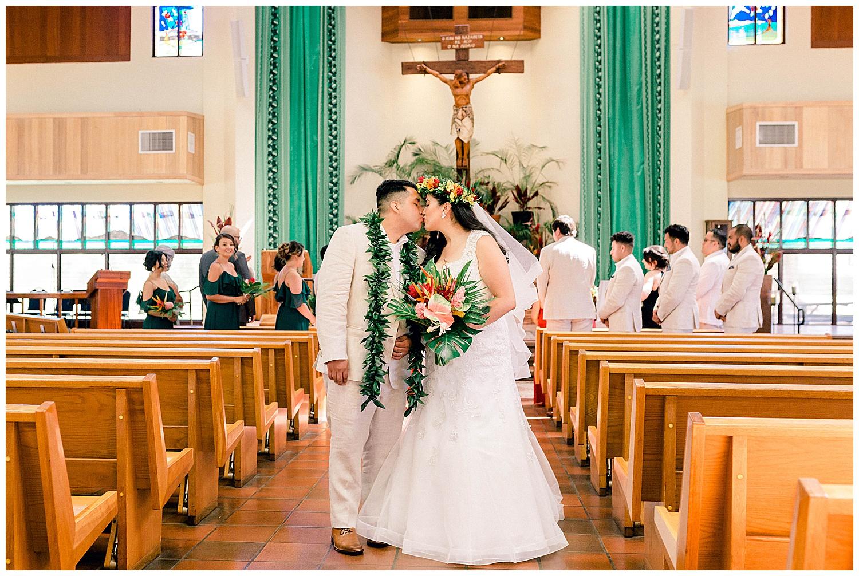 First kiss during Catholic wedding ceremony in Kihei, Maui