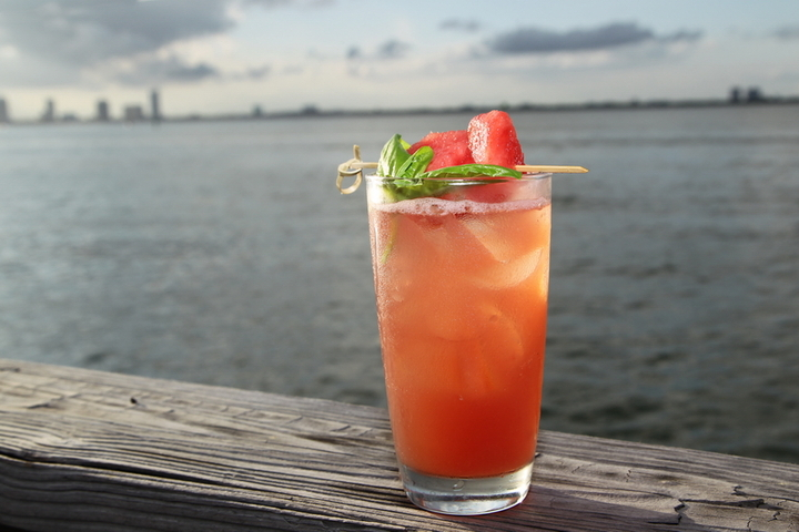Agua Fresca:  Rose syrup is the hidden ingredient that adds a subtle yet essential layer to enhance the fresh basil. Juicy watermelon and lime is added to create complexity, and when prepared properly this is the perfect well-crafted mocktail.   Ingredients : 3 or 4 cubes of fresh cut Watermelon A1 1/2 oz Organic Rose Syrup (we use Royal Rose organic syrups) Add chiffonade of Fresh Basil (about 2 large leaves) 1 oz fresh lime juice 6 oz Perrier   Muddle fresh cut Watermelon and add the Organic Rose Syrup. Add fresh basil and lime juice, then top with Perrier. Shake vigorously. Garnish with a fresh basil leaf and watermelon cubes.