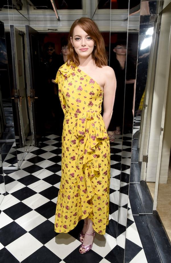 Emma Stone wore a yellow floral print Gucci gown.