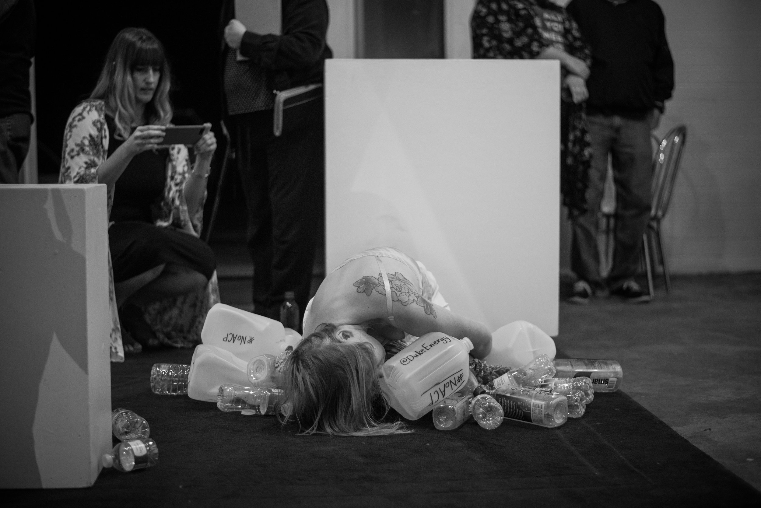 Slowly, Painfully, by Poison  was a live art body installation performed at Hart Witzen Gallery in Charlotte, NC, on April 21st, 2018.   This was a ritual death-dance in protest of the fracked-gas Atlantic Coast Pipeline.  Observers were invited to spread photos and videos via social media, specifically tagging NC Governor Cooper, Duke Energy, and Dominion Energy as entities of power responsible for this violence.  Photography captured by Jessica Britton of Birdi Photography