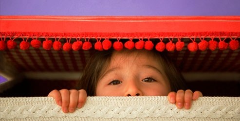 getty_rf_photo_of_child_playing_hide_and_seek.jpg
