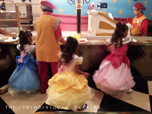 These three came dressed up as the Disney Princesses (Cinderella, Belle and Sleeping Beauty)…how did they get their dresses on the rides?!