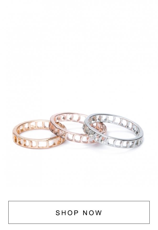 Kit com um anel rosê, um dourado e um prateado