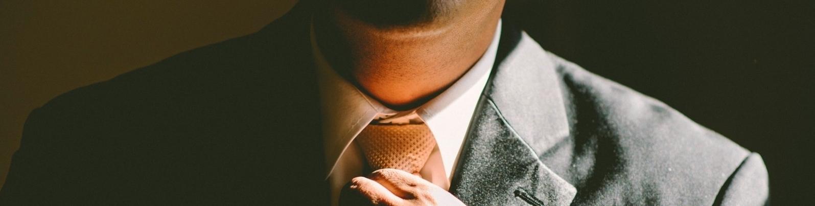 man-adjusting-tie.jpg