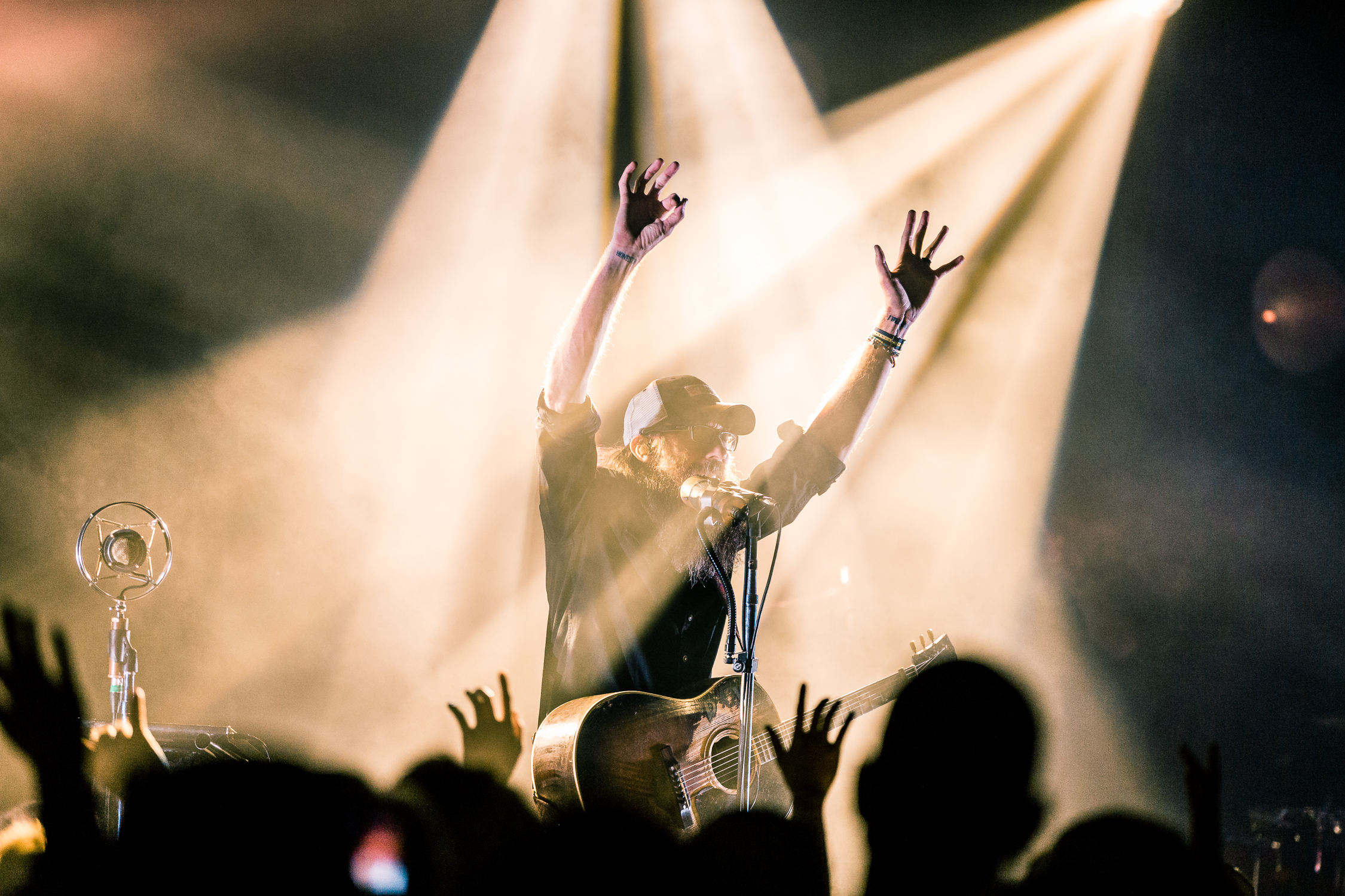 In my opinion this is the stronger image because of the parallel between David Crowder's raised hands and the single audience member's who is perfectly in line with my camera. This creates more emotion in the image and conveys more of a story/meaning.