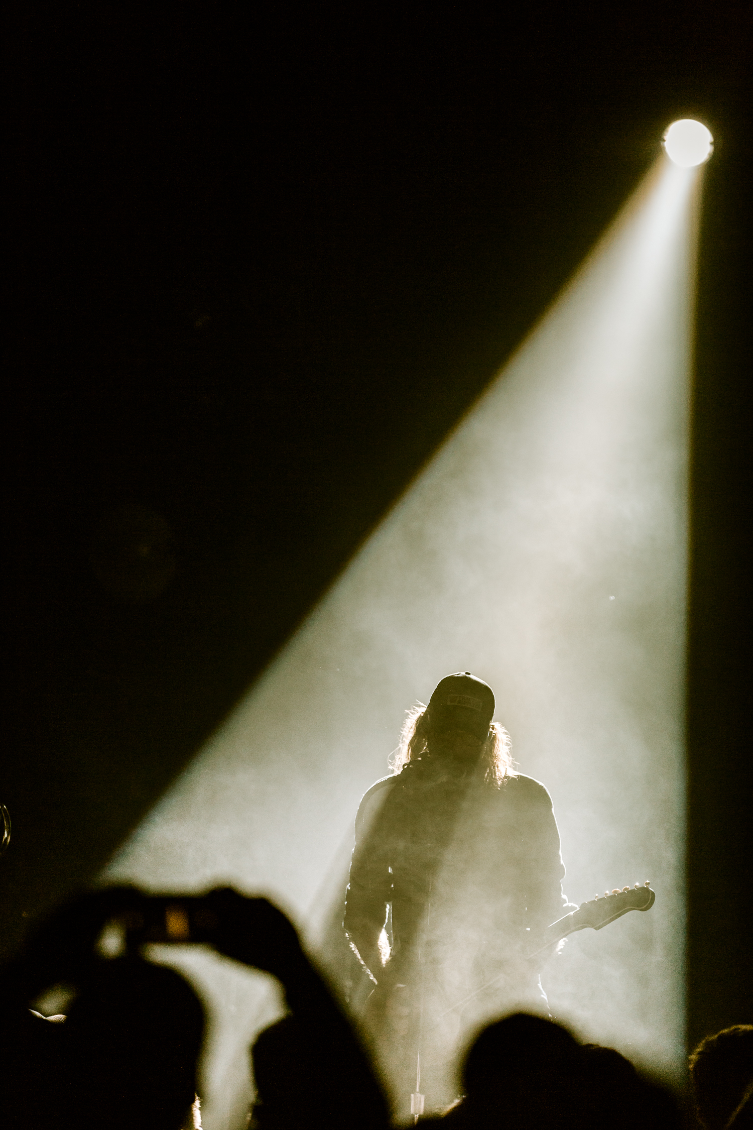 As a live music photographer you have to be ready for sudden changes. This shot came out of nowhere when the lighting changed suddenly. I dropped my exposure by a stop and a half by shortening my shutter speed because I didn't want any background details surrounding Crowder and create this silhouette feel.