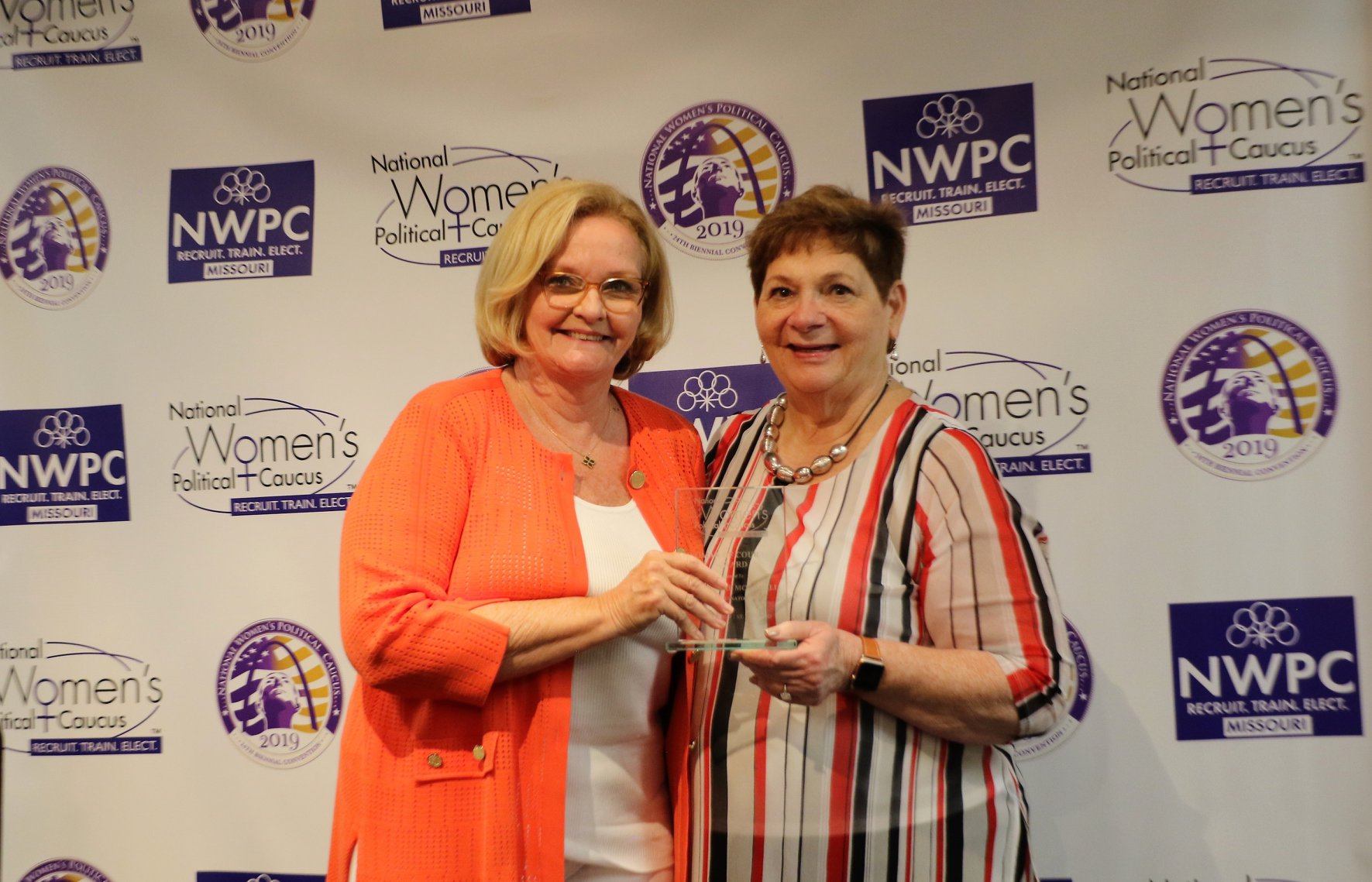 Former Senator Claire McCaskill receiving Women of Courage award from NWPC President Donna Lent -