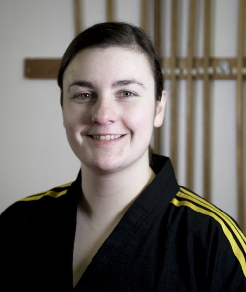 Master Sera Prokopiw - Sera Prokopiw has been doing martial arts for 23 years and teaching for 12 and is a certified Dojang Coach with Sport Canada. She is a 5th dan black belt master in taekwondo and former competitive fighter. Her current passion is  learning as many weapon styles as possible. She is committed to constantly improving her own skills and broadening her knowledge to deliver the best training possible to her students. She believes in a strength-based approach to teaching and prioritizes maintaining a safe space for all students to learn.