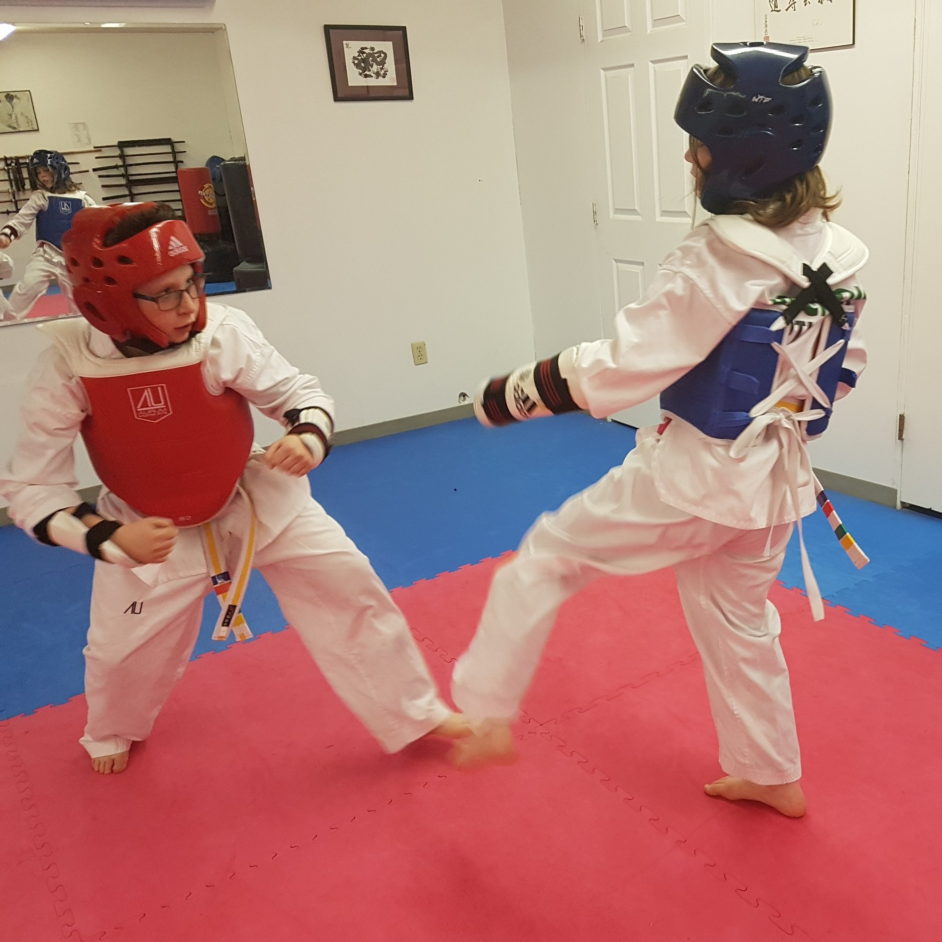 Competition Training - Sun 12:00-1:30 This class is for students who wish to spar competitively at tournaments. Students learn the rules of Olympic style sparring (World Taekwondo) and get more practice with contact than in regular classes. They also do sparring-specific conditioning.