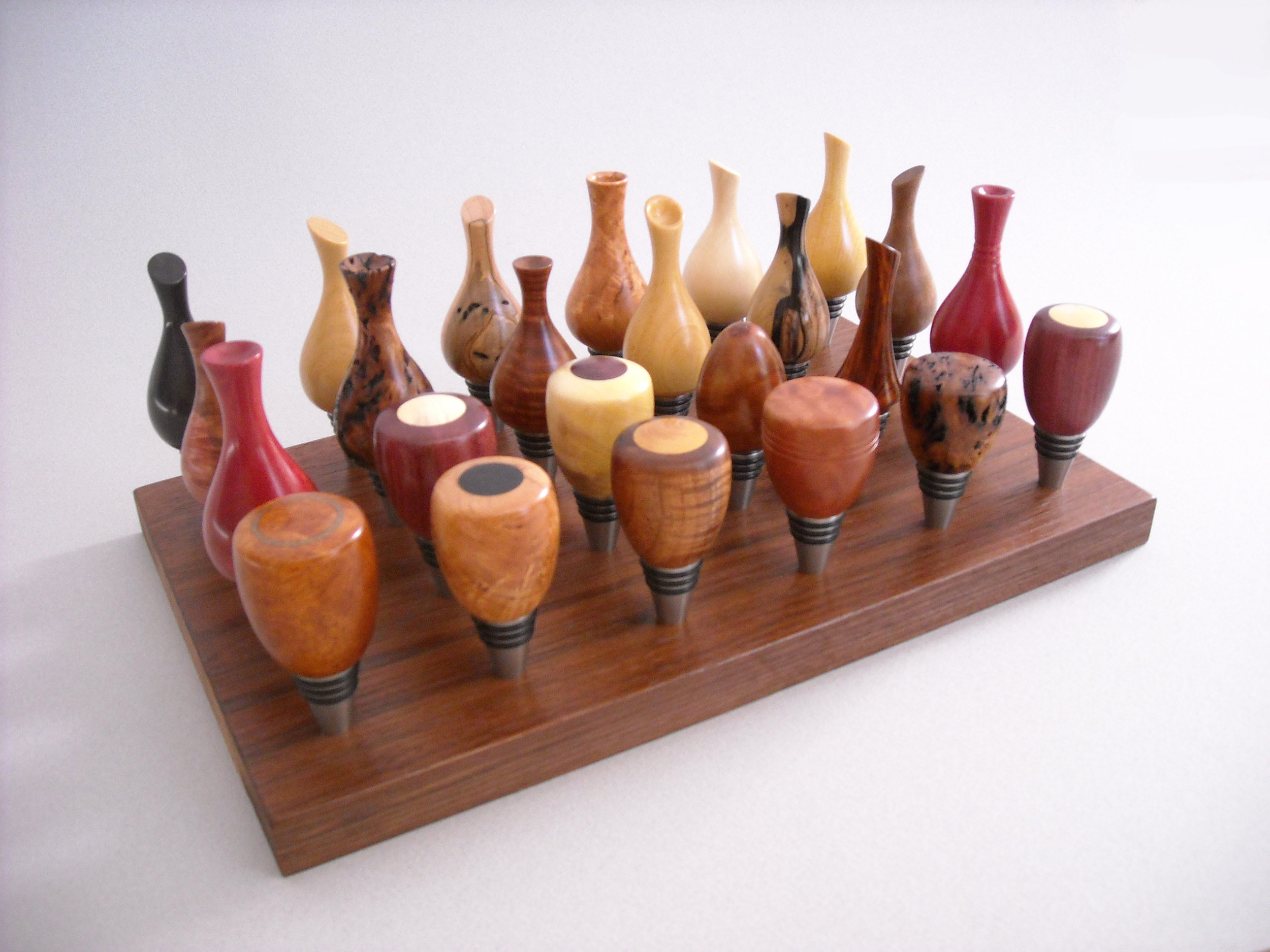 A flock of stainless steel wine bottle stoppers
