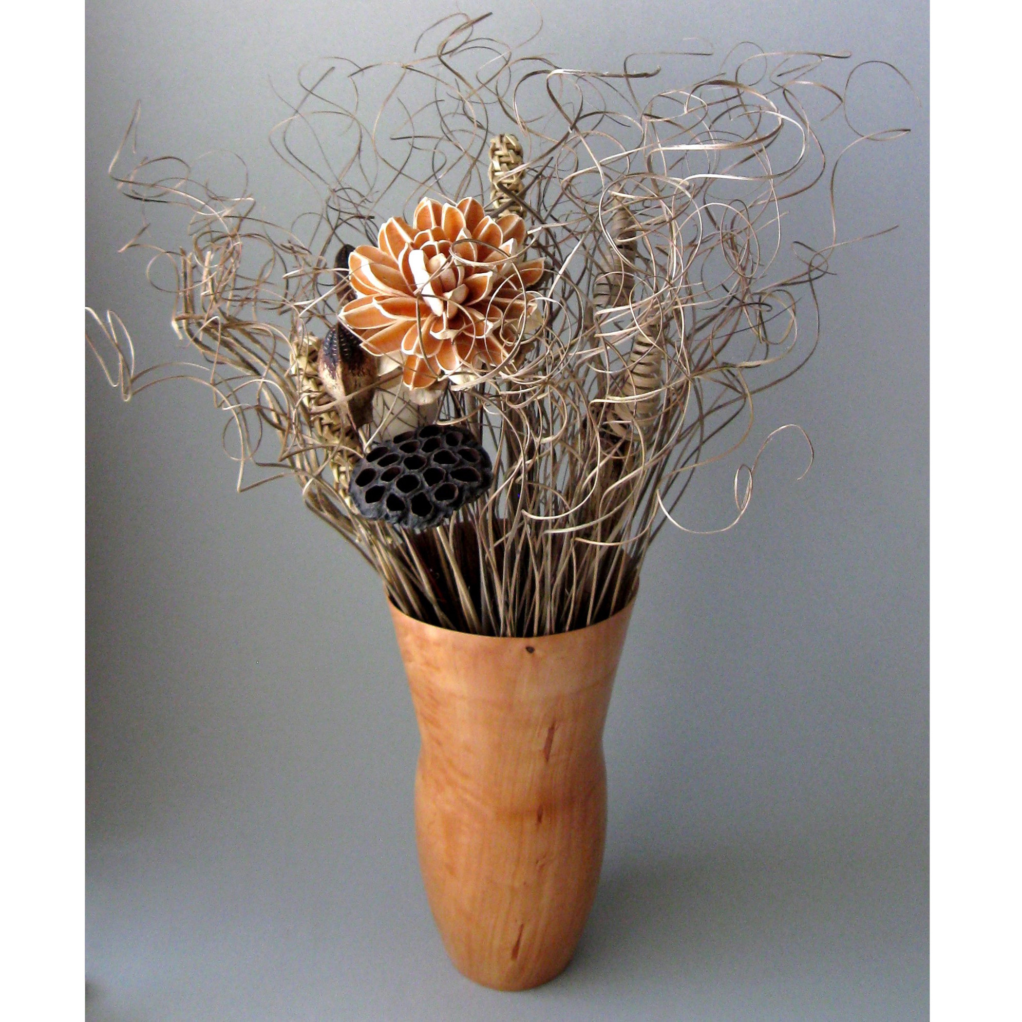 Artistic carrotwood vase