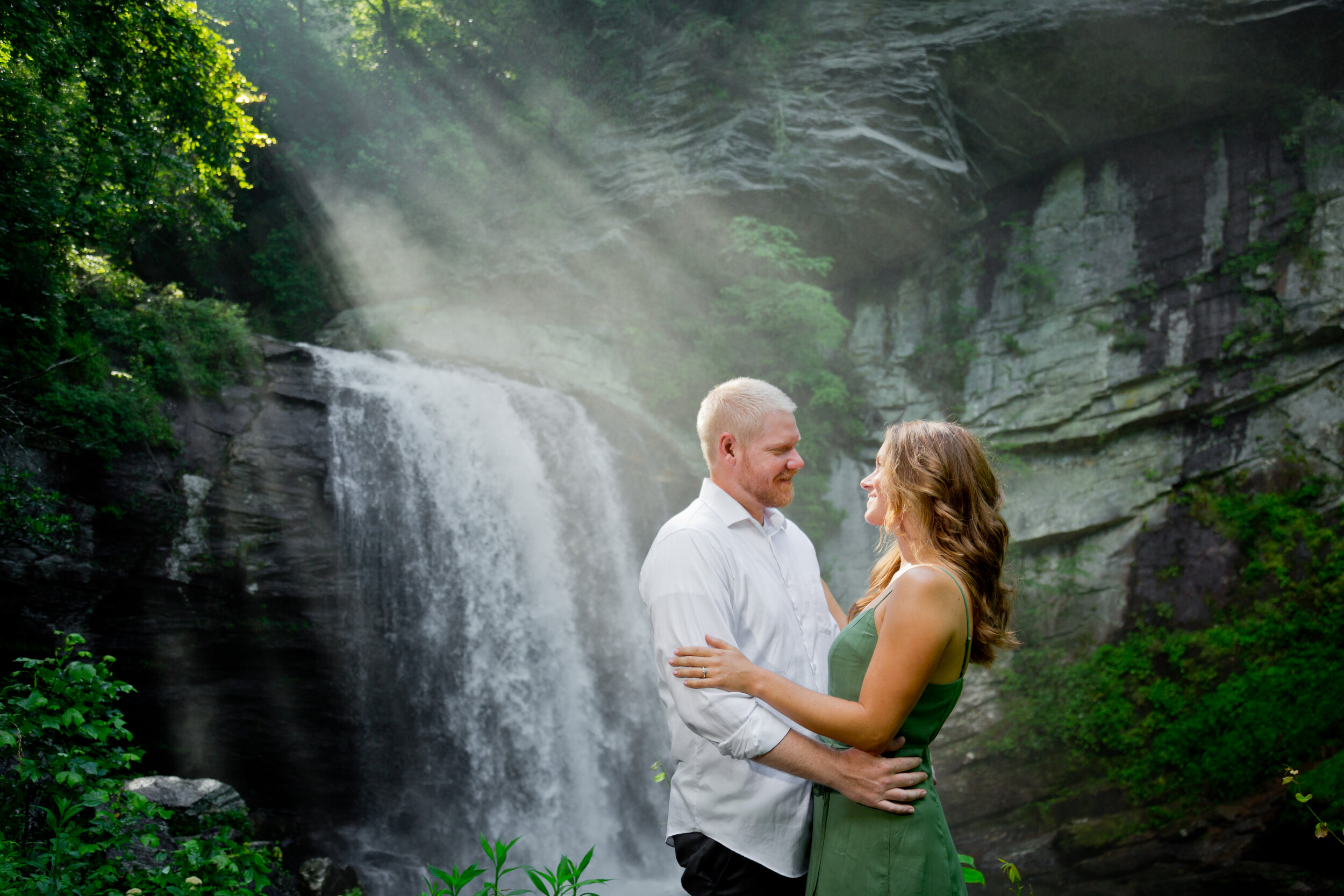 Beautiful Waterfall Engagement Photos - Zack took our engagement photos at Looking Glass Falls last summer. We didn't know what to expect, but the experience was great. The location was beautiful, but unexpectedly very crowded that morning. Zack worked great through the cold water, slippery rocks, and somehow managed to dodge the crowd and get some amazing shots. He is super easy to work with, very responsive, and is an experienced and talented photographer. I cant wait to work with him for my bridals this month and our wedding next month. I highly recommend Zack Bradley Photography!