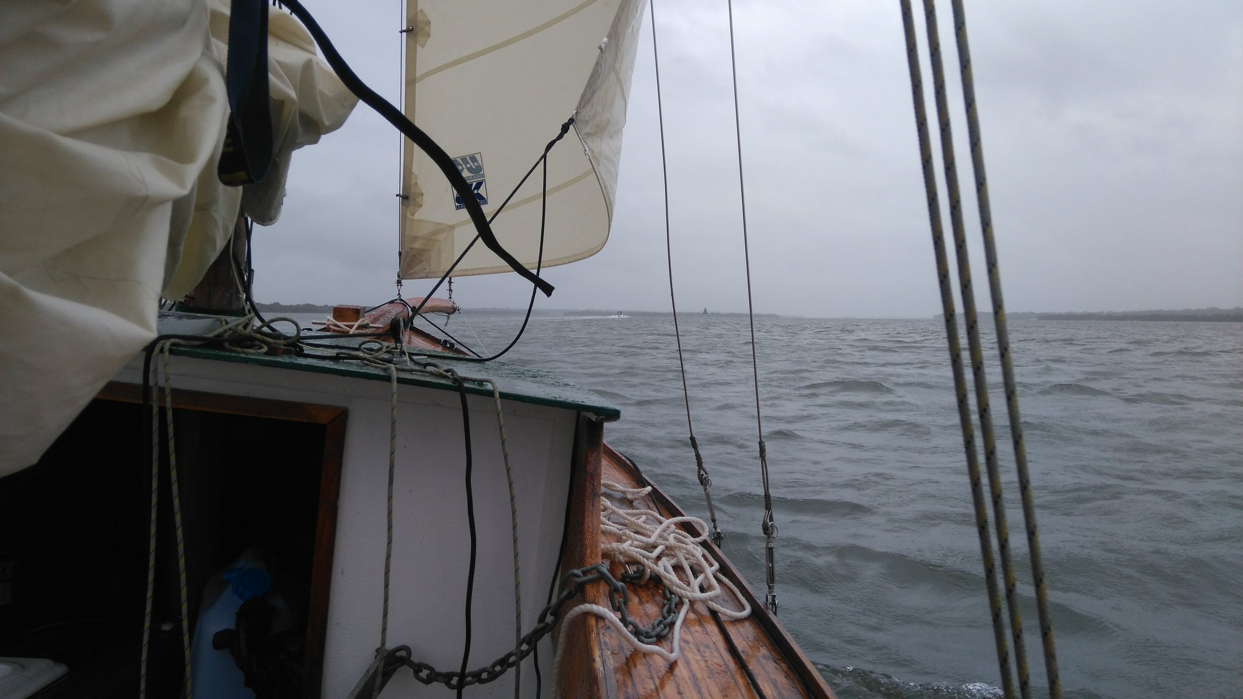 I sailed on under just a headsa'l, the southerly building throughout the day, until I'd turned the corner and could take shelter on the windward shore.