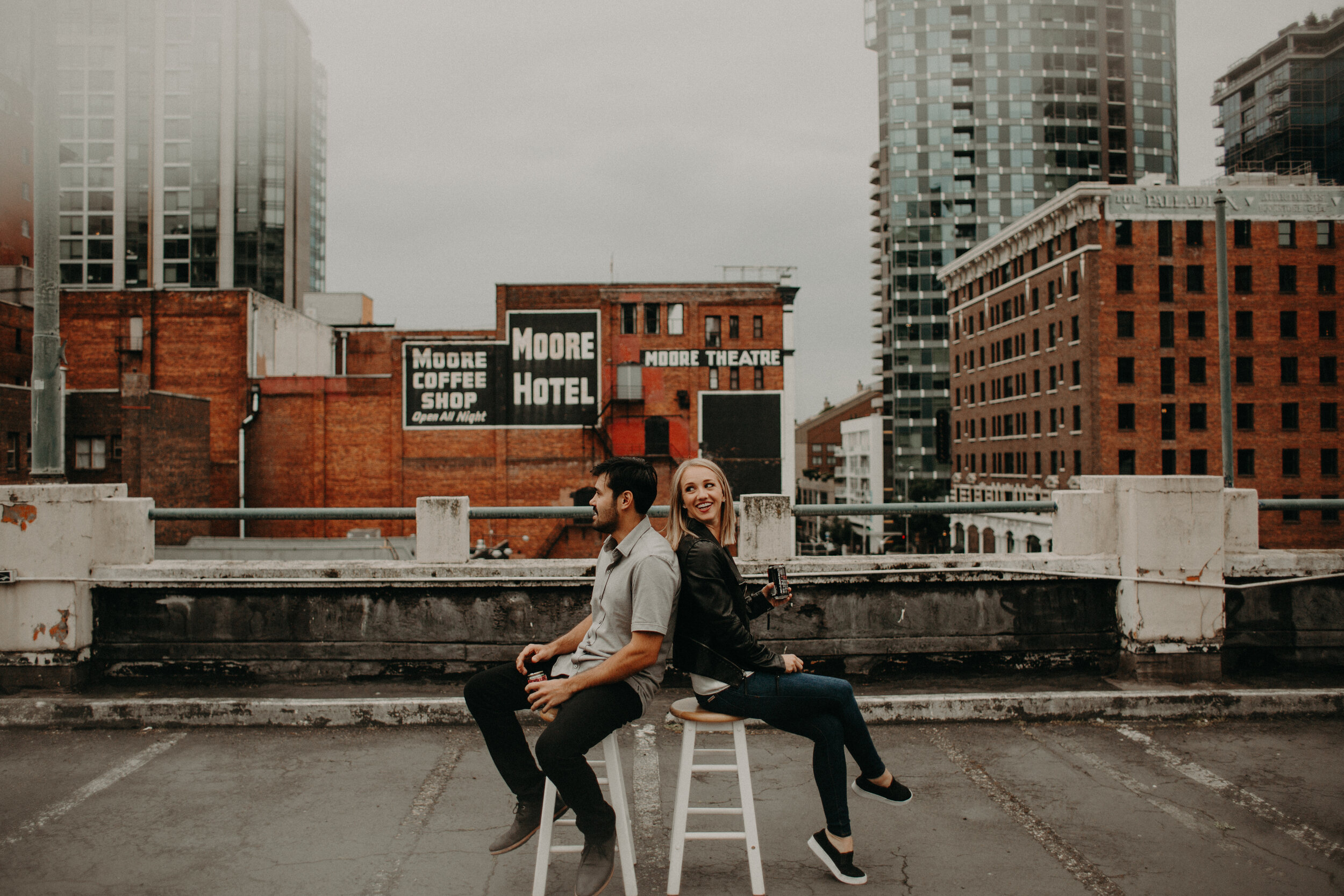 Moody Engagement Sessionin Downtown Seattle - Josh + Haley picked up and moved from Hawaii to themisty goodness of the PNW! To celebrate their big move weexplored the urban landscape of Downtown Seattle & crackedopen a couple of ciders from Schilling Cider - YUM.