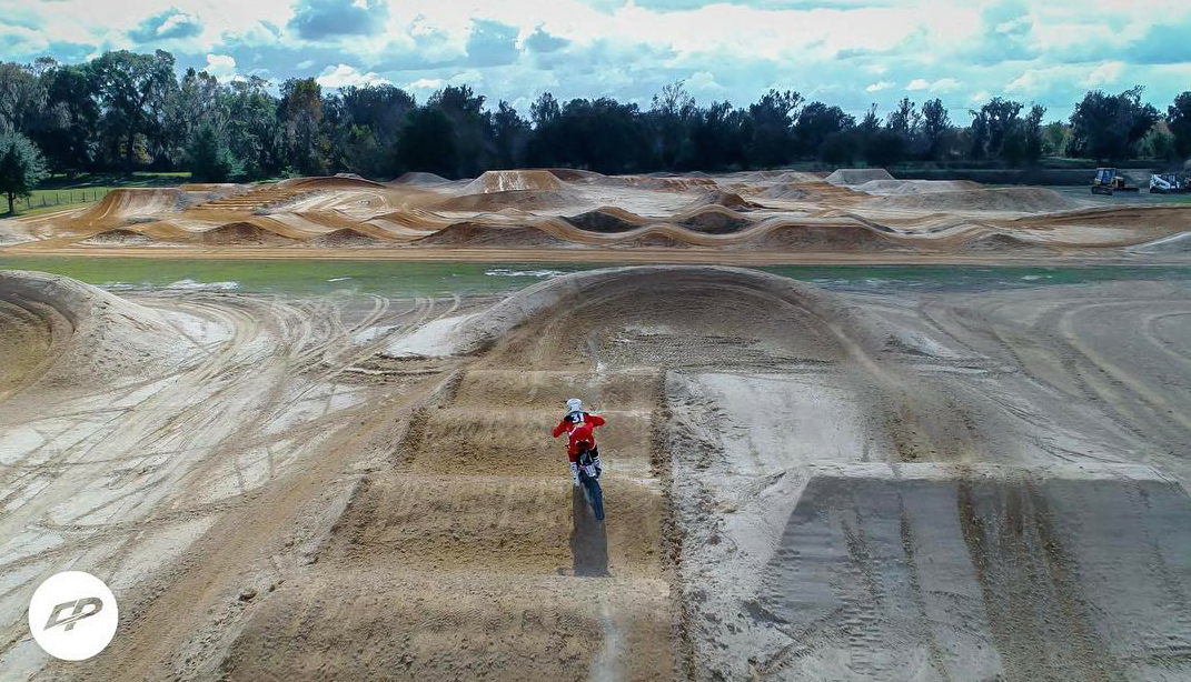 Cole works with the top athletes in the sport of Supercross and Motocross. Pictured is a great shot from Cole of Geico Honda rider RJ Hampshire putting in laps down in Florida.