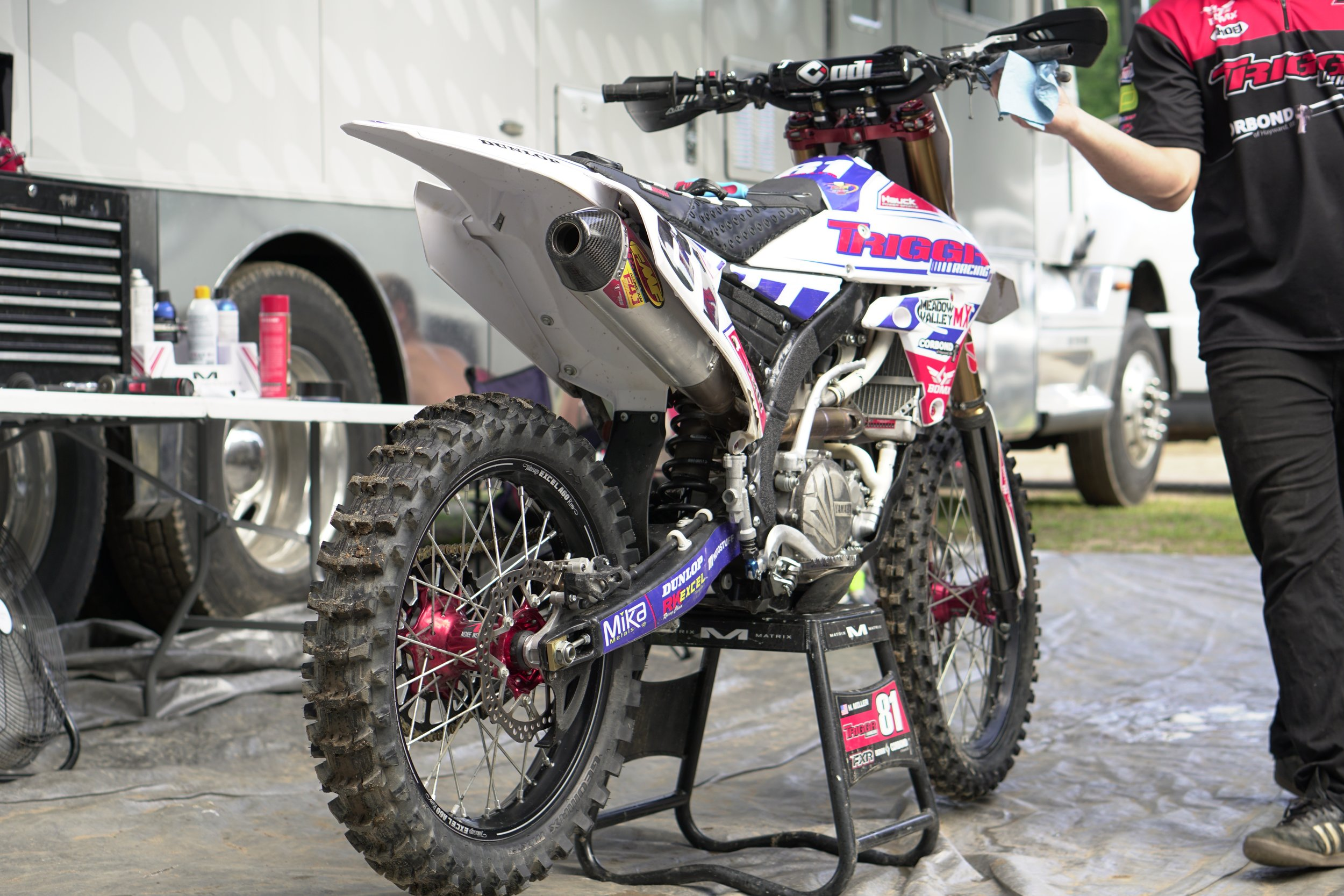 The Triggr Racing YZ450F of Henry Miller is a work of art. Has keeps his bike looking awesome each weekend and is super quick with any changes or repairs that Henry needs. Even without the support of a big factory team these two manage to beat up some big name riders. Its always great to see privateer teams achieving high levels of success each week. Here Chas makes some quick adjustments to deal with the torturous Southwick sand while Henry and him discuss the track and their approach to the day.