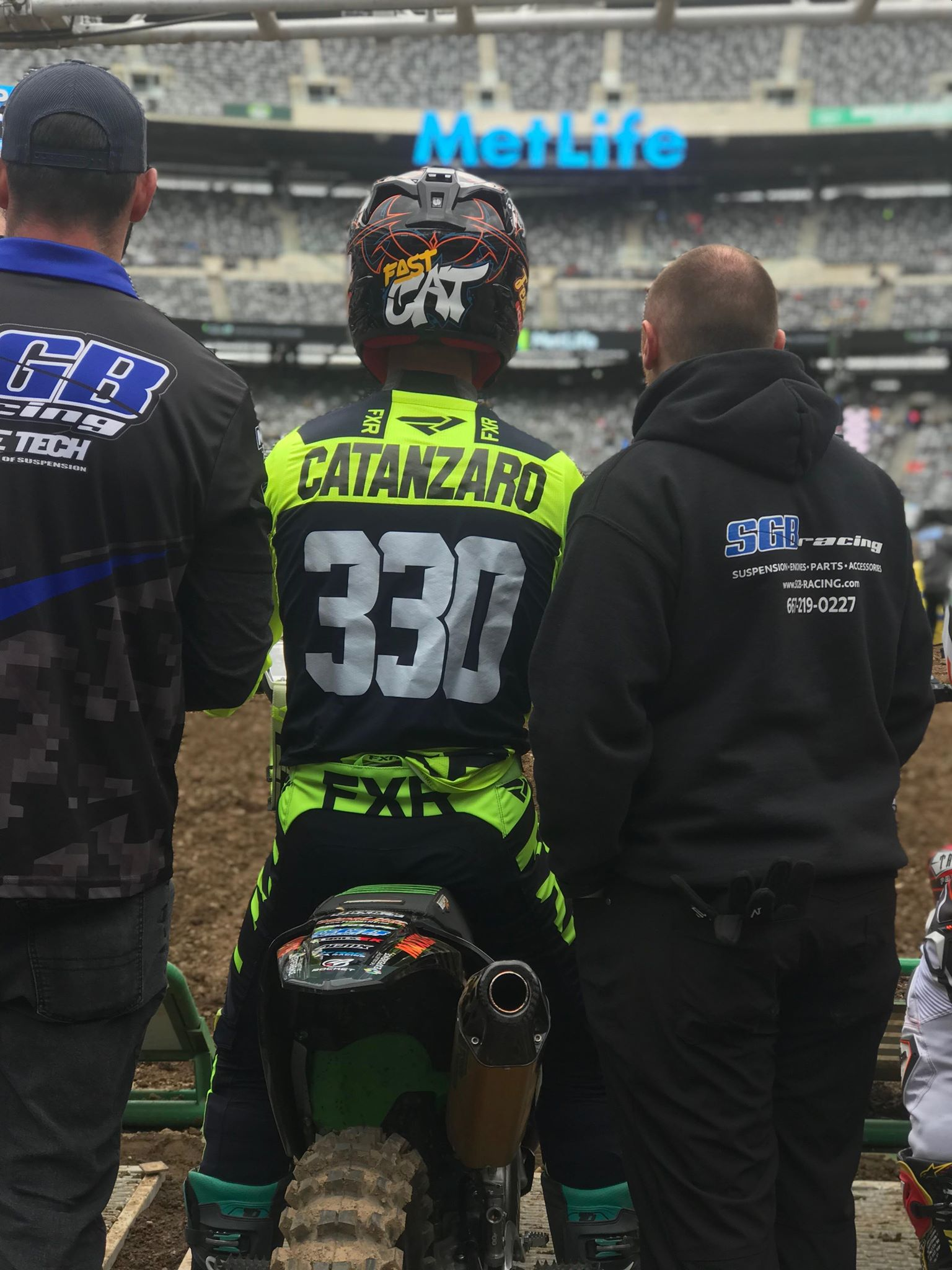 TCE rider AJ Catanzaro gets set for the gate drop with his crew mechanic Jason of SGB Racing and Mac Engel.