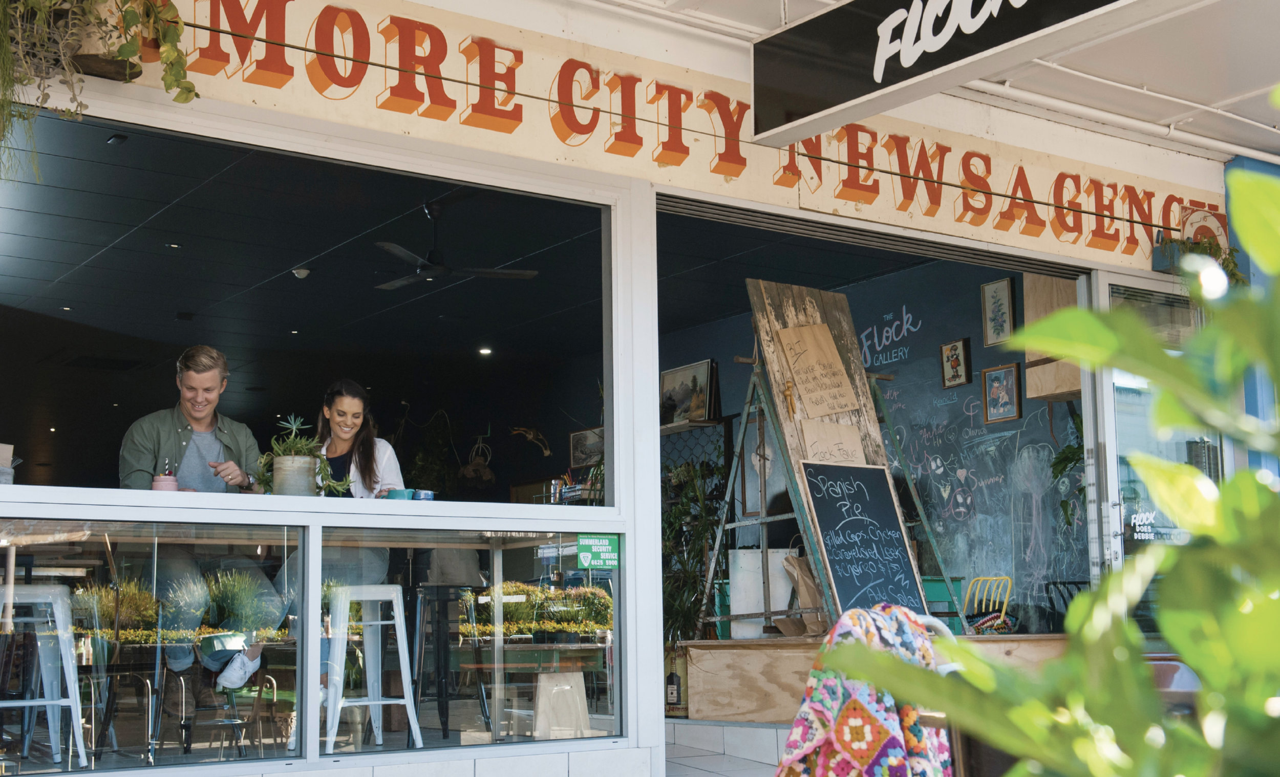 Location Photo: Couple enjoying food and drink at Flock Cafe, Lismore | Credit: Destination NSW