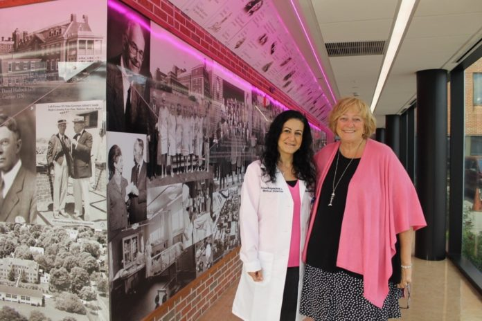 Dr. Edna Kapenhas, the medical director of the Ellen Hermanson Breast Center at Stony Brook Southampton Hospital, and Susie Roden, the center's patient navigator and outreach coordinator, dressed in pink for the spirit of National Breast Cancer Awareness Month. Christine Sampson photo