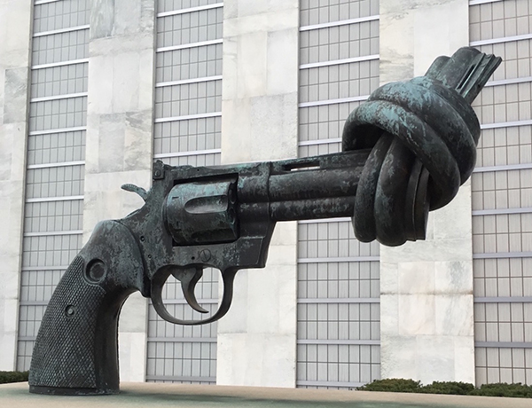 """""""Non-Violence"""" by Carl Fredrik Reuterswärd at United Nations. Photo by Leo Colfax."""
