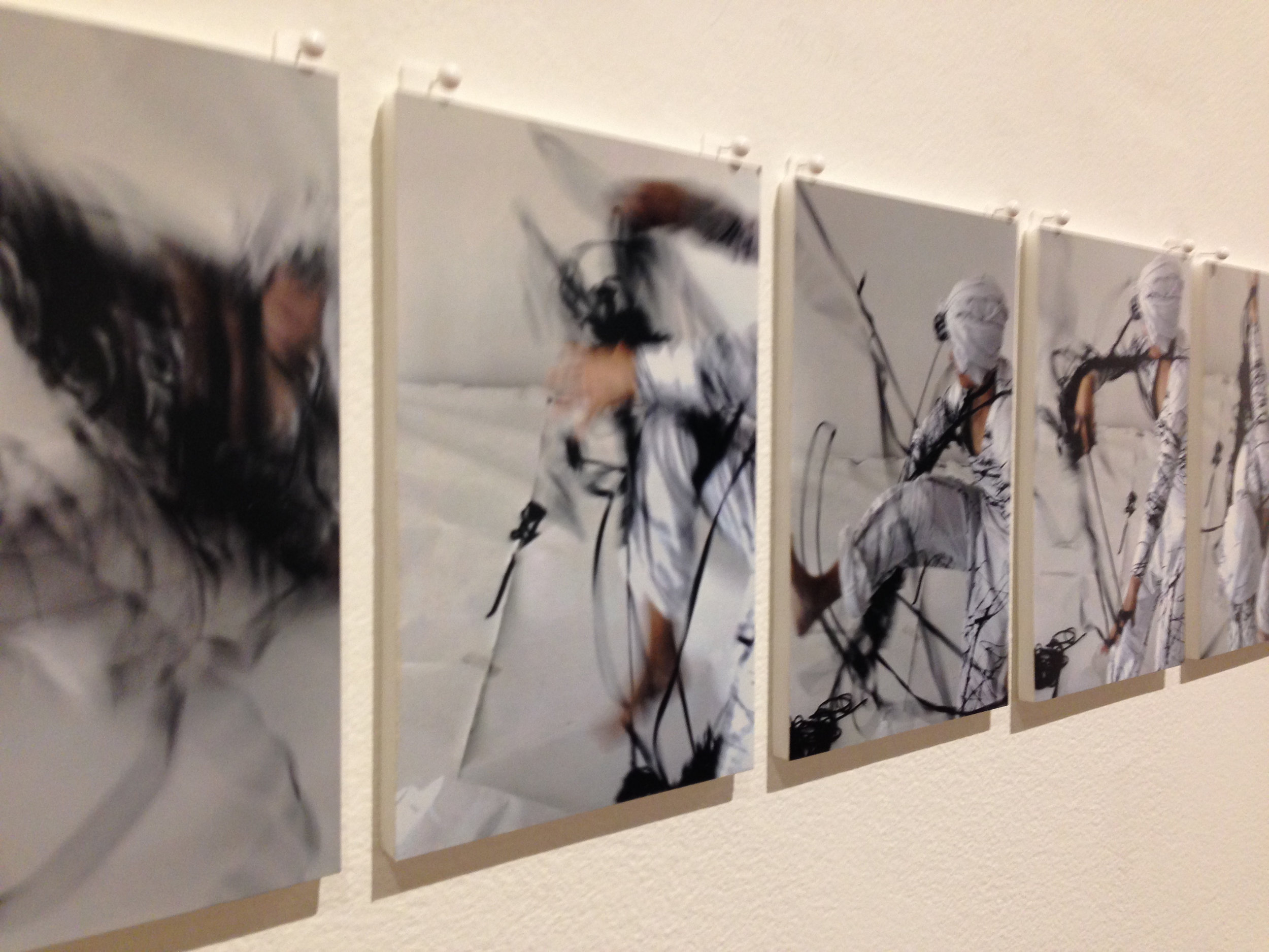 Nicci Haynes,  Etching performance at Mount Stromlo (installation view) 2013, Filmed by Lomokino (hand-cranked camera) on 35mm slide film digitsed and housed in and wooden shadow box 24 cm 30 cm x 8cm (From the series  Body language ).